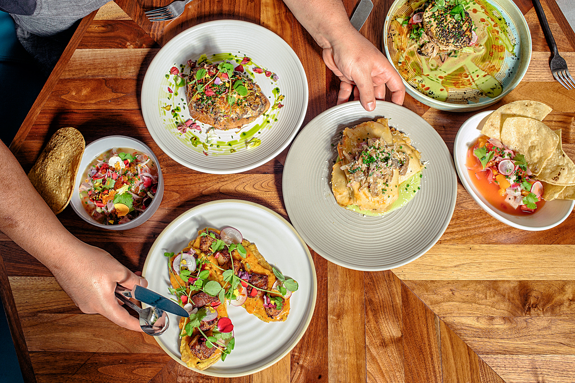 Pimento cheese tostones and other dishes at the Cortez, one of a number of new culture-crossing restaurants in the South