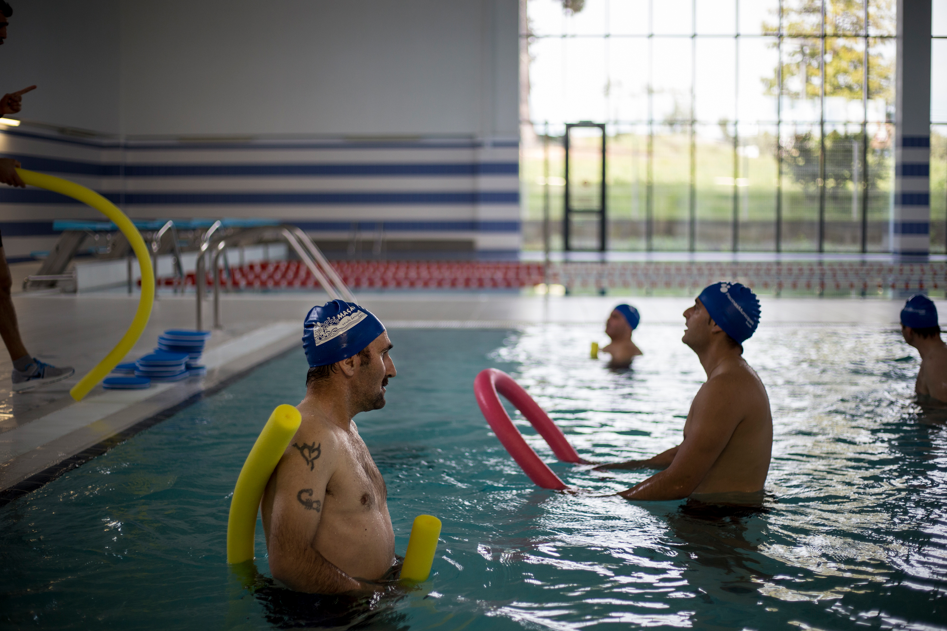 """""""When I got here two months ago I had to undress myself for the medical checkup. The doctor looked at me and said 'You truly are a human skeleton. You got here just in time,'  he recalls, while patting his new formed belly in the locker room before his weekly hydro gymnastics class March 30, 2018."""