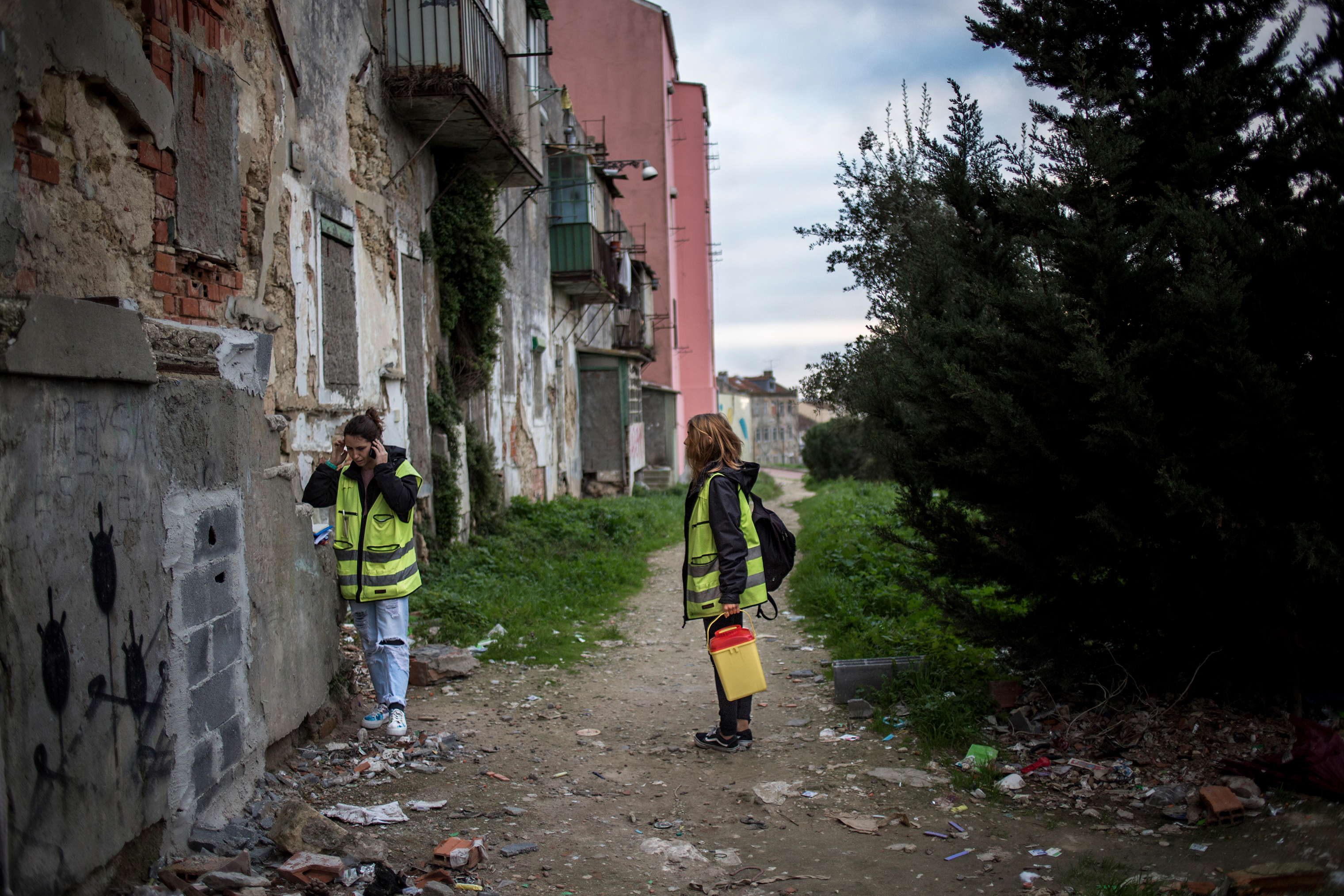 """Andreia, a social worker from Crescer, a state-funded outreach organization, plans her next move at one of Lisbon's many open-air """"consumption rooms,"""" January 12, 2017. She and Rita, a psychologist, are a part of the first line of help in the Portuguese Harm Reduction Policy."""