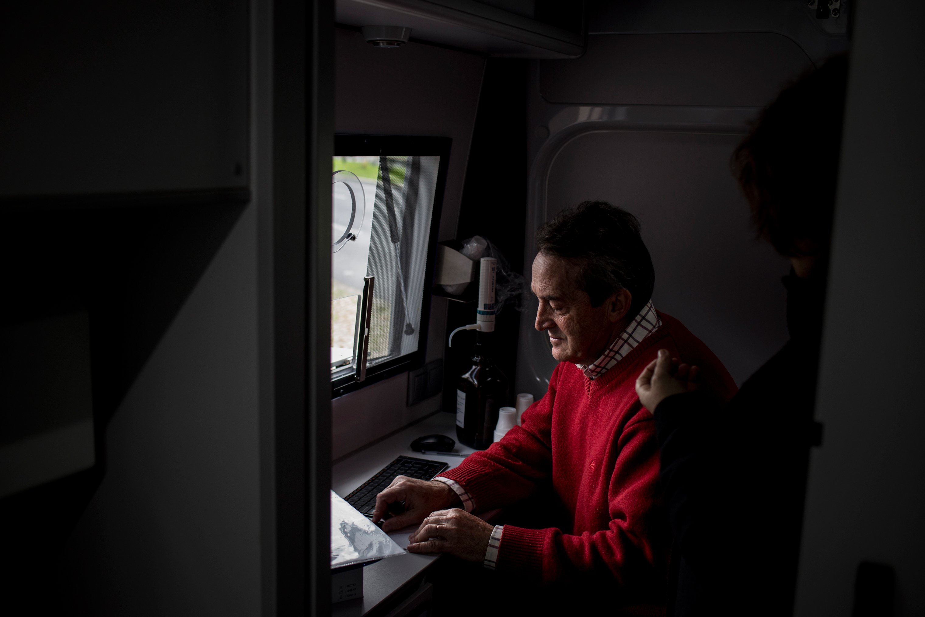 João, a 60-year old nurse, searches for a patient's doses at a state sponsored mobile methadone clinic in Lisbon, February 9, 2017. It is operated by the Ares do Pinhal Association, and has existed since the Casal Ventoso neighborhood was demolished. The two vans administer methadone maintenance therapy to more than 1,200 people every day. Opioid users who receive this treatment on the street are healthier and safer than those who do not.