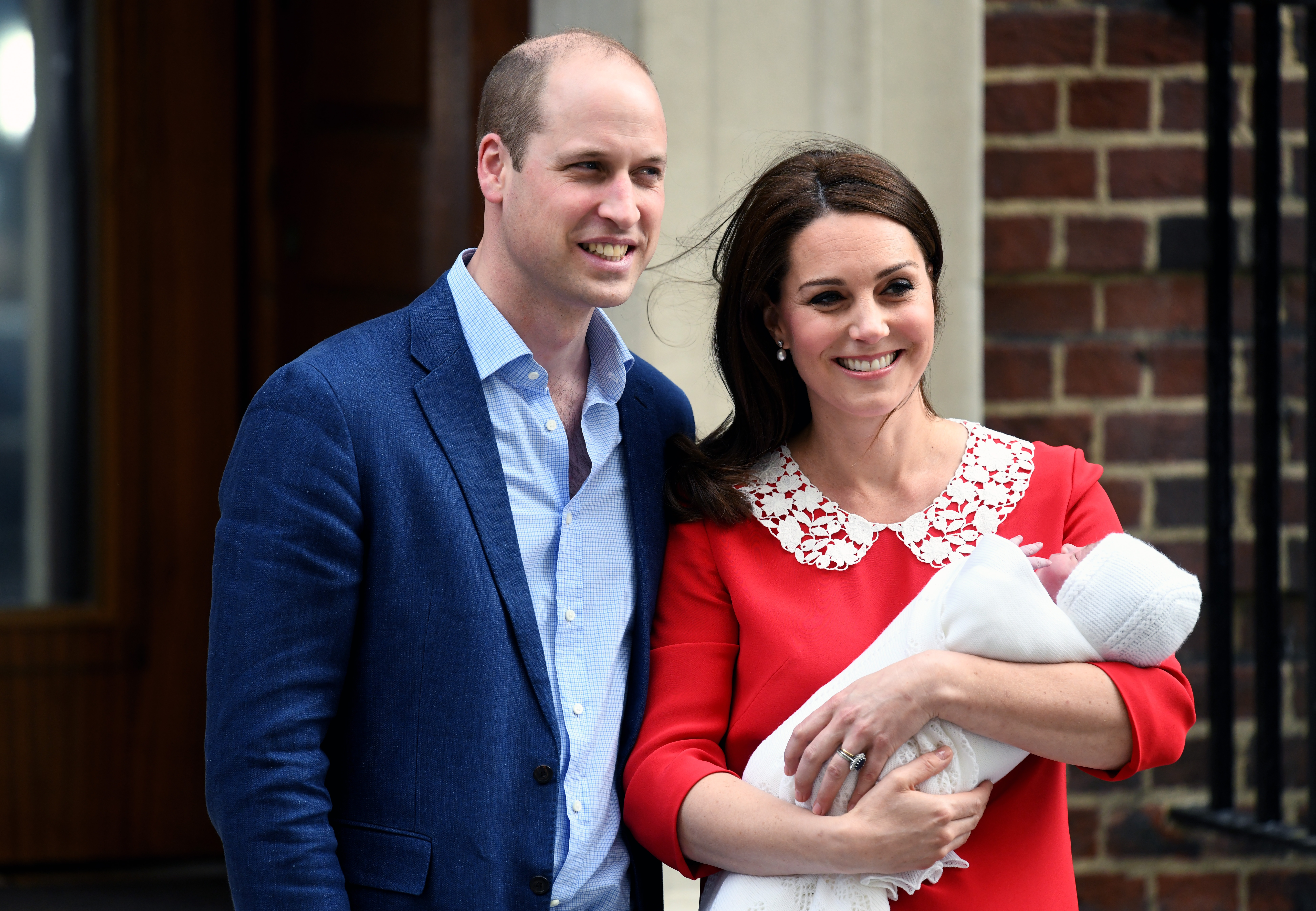 Prince William, Duke of Cambridge and Catherine, Duchess of Cambridge leave St. Mary's Hospital with their newborn son Prince Louis of Cambridge.