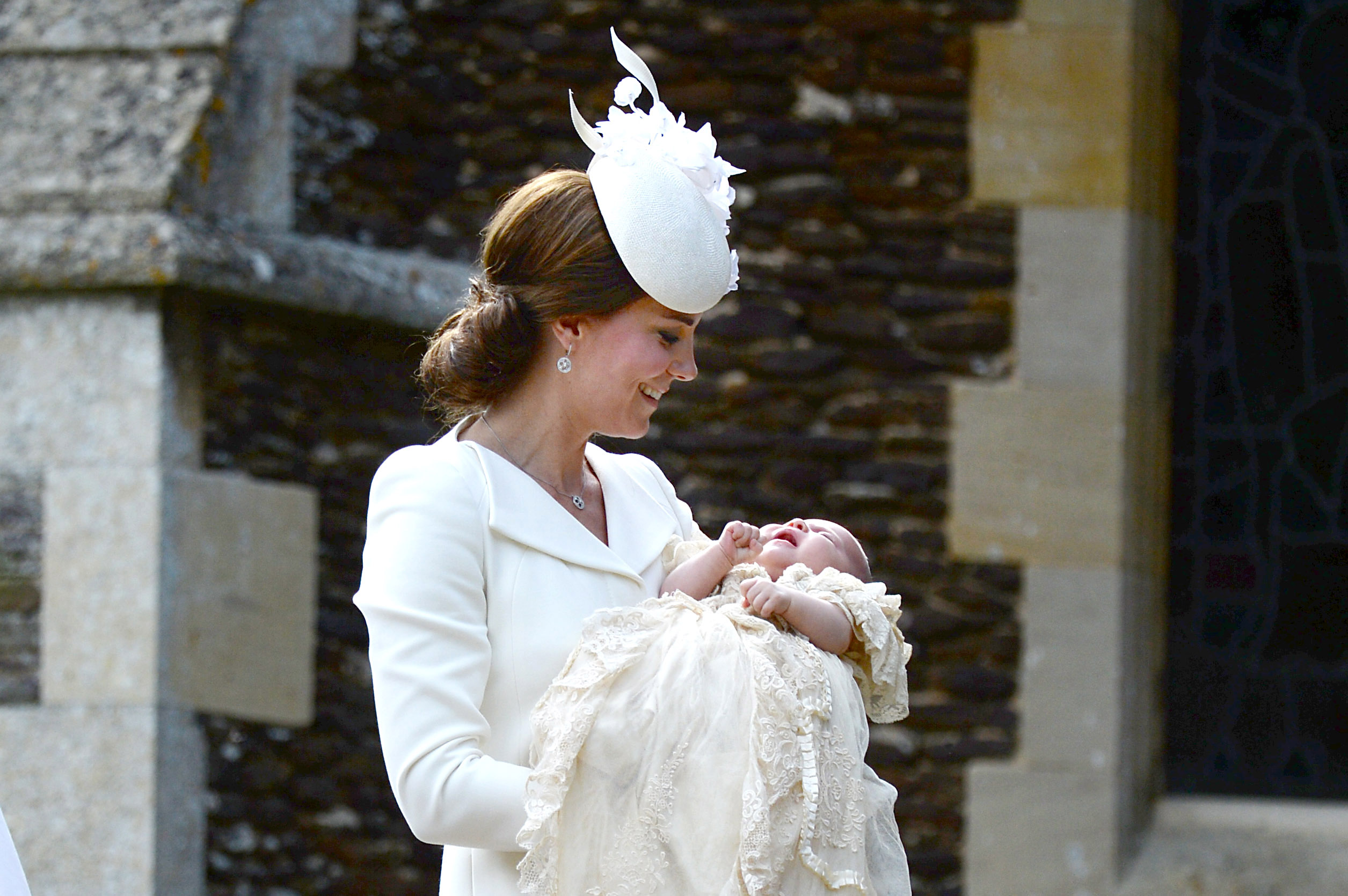 Catherine, Duchess of Cambridge and Princess Charlotte of Cambridge arrive at the Church of St Mary Magdalene on the Sandringham Estate for the Christening of Princess Charlotte on July 5, 2015.