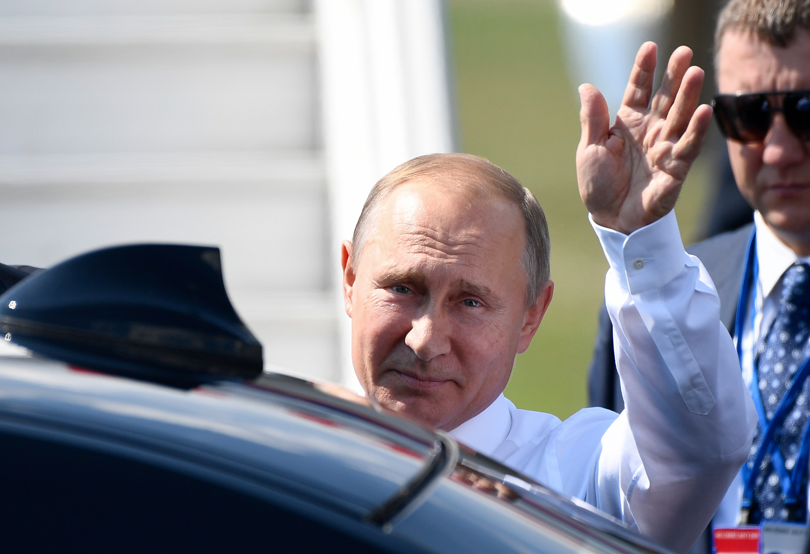Russian President Vladimir Putin waves upon his arrival at the Helsinki-Vantaa Airport in Helsinki, on July 16, 2018 prior to a summit  between him and the U.S. President.