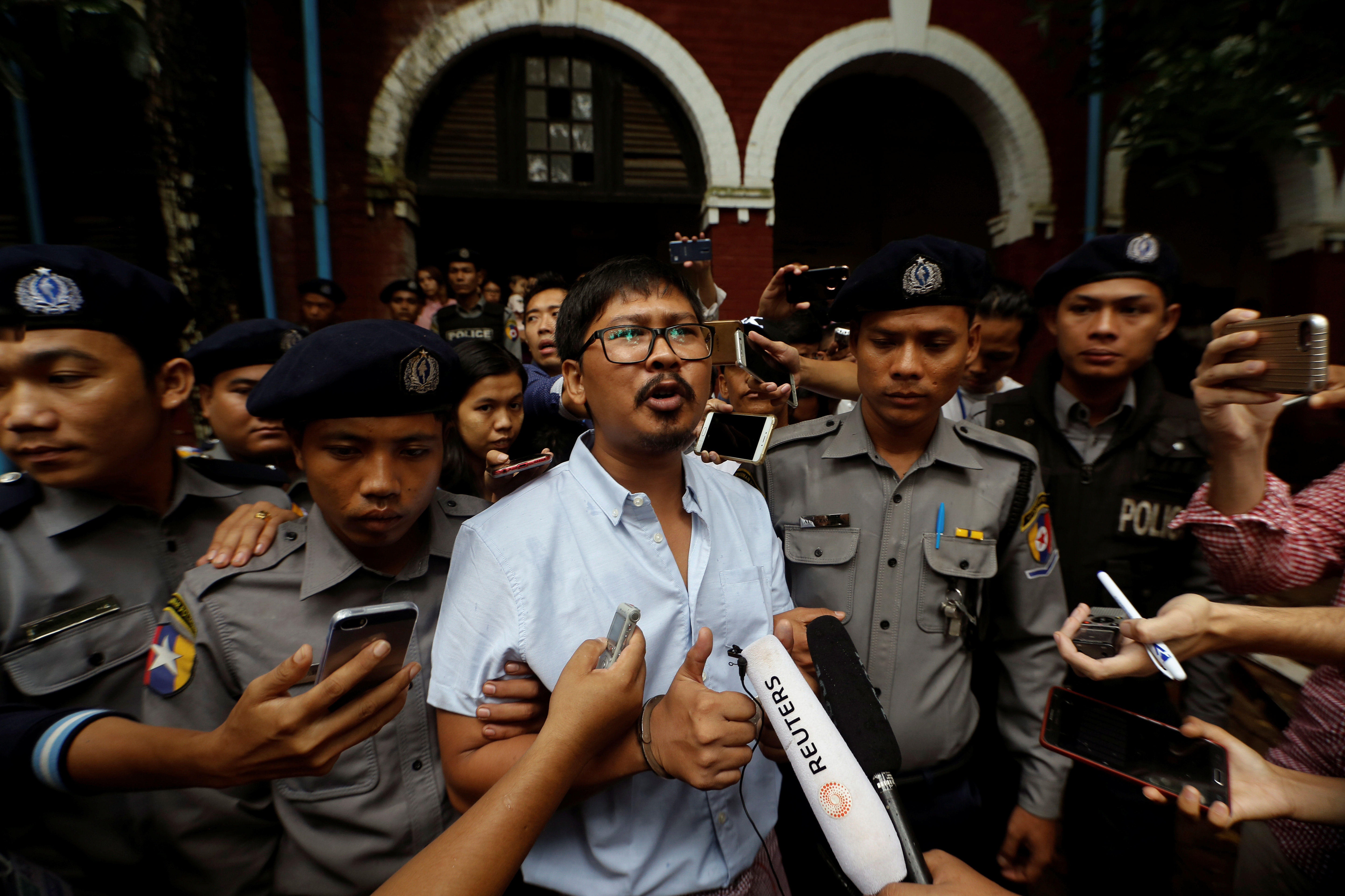 Detained Reuters journalist Wa Lone speaks to the media while leaving Insein court in Yangon, Myanmar July 9, 2018.