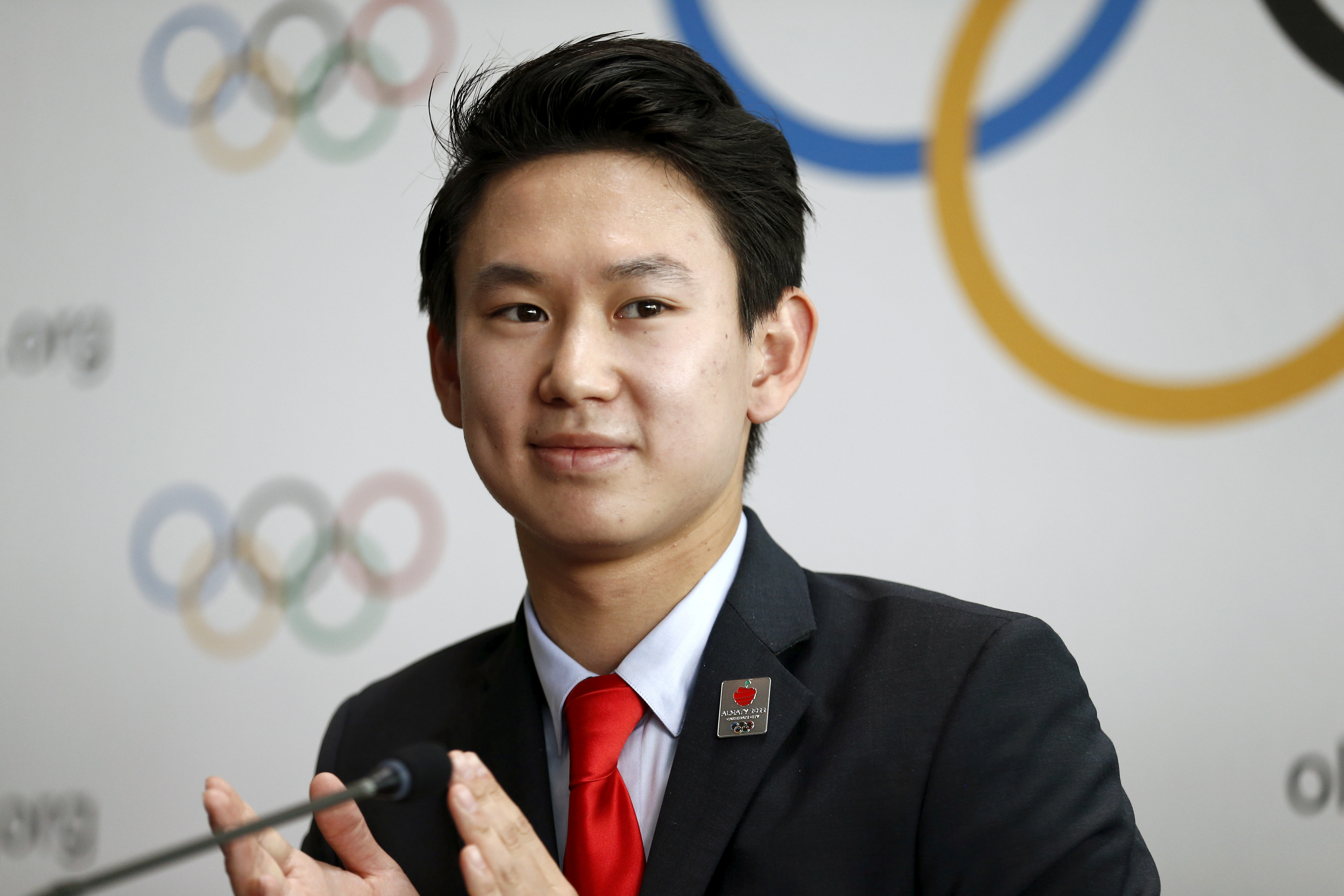 Denis Ten of Kazakhstan, bronze medalist in men's singles figure skating of the 2014 Winter Olympics in Sochi, attends a news conference after the briefing for International Olympic Committee (IOC) members by the 2022 Winter Olympic Games candidate city of Almaty at the Olympic Museum in Lausanne, Switzerland, June 9, 2015.