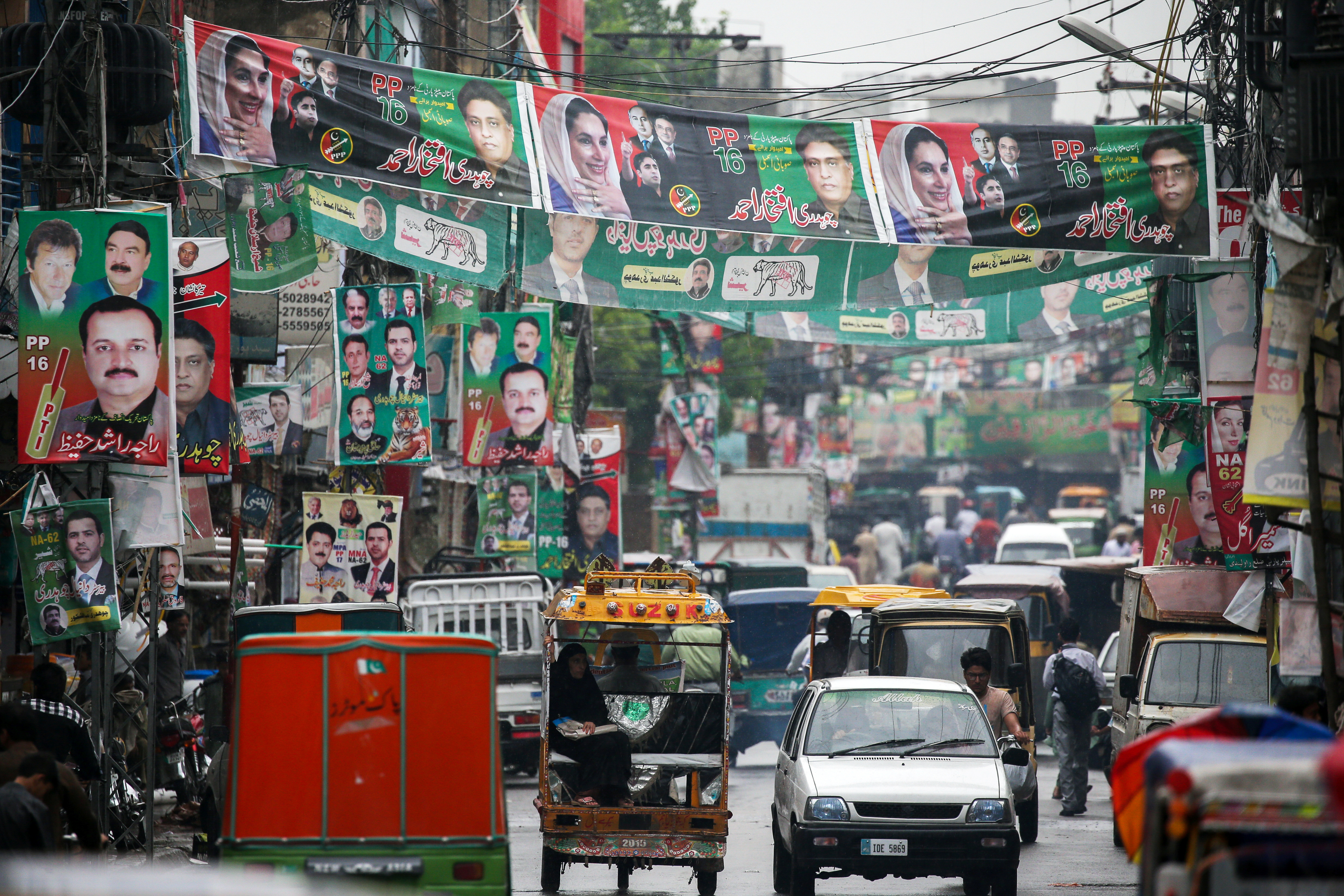 A street is decoreated with flags and banner of political parties ahead of general elections in Rawalpindi, Pakistan, July 23, 2018.