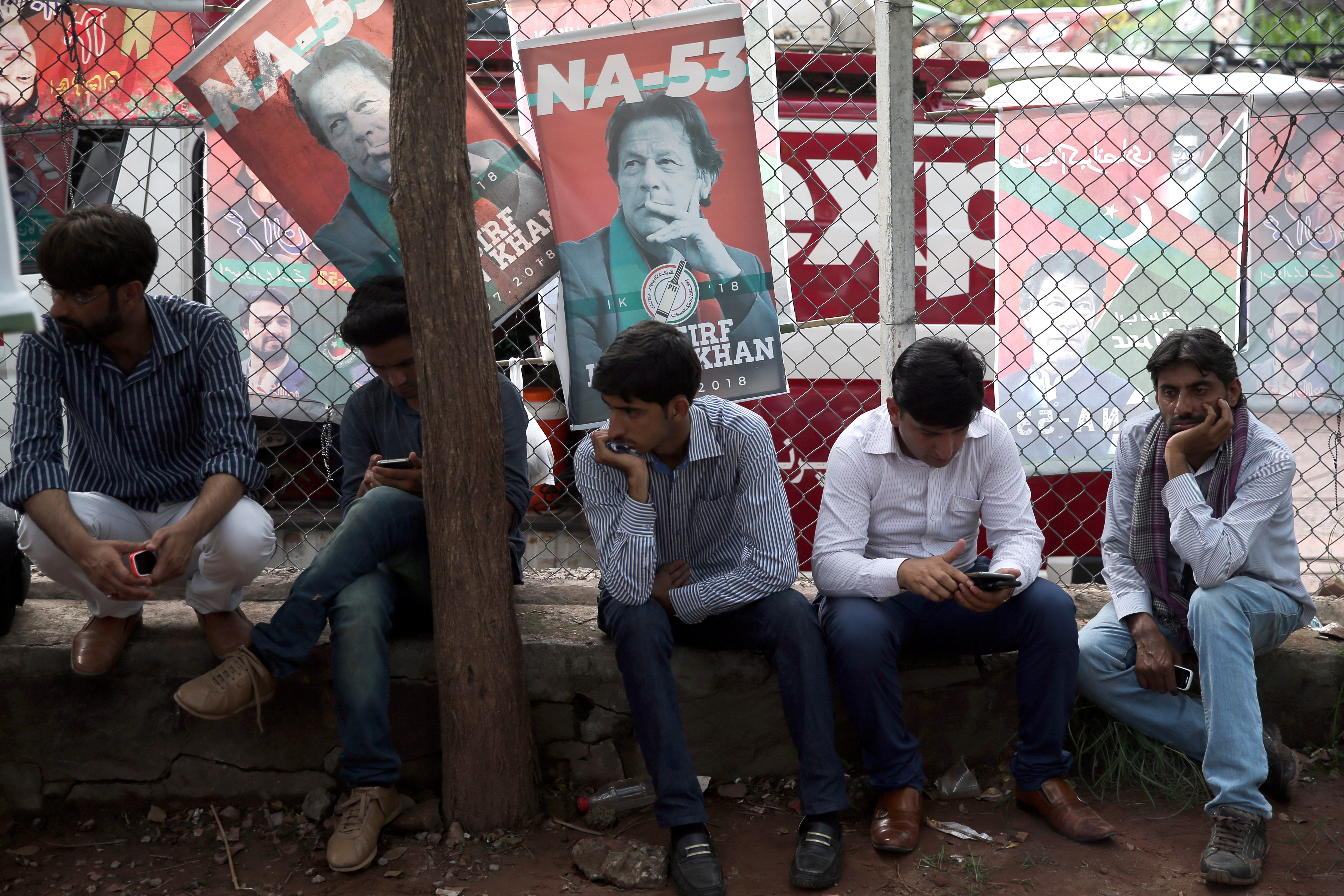 Supporters of cricket star-turned-politician Imran Khan, chairman of Pakistan Tehreek-e-Insaf (PTI), wait outside his residence, a day after the general election in Islamabad, Pakistan, July 26, 2018.