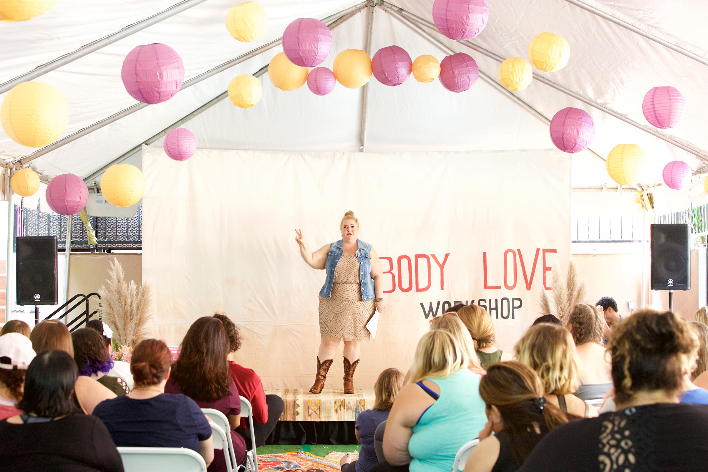 Self-Love Mentor and Wellness Advocate Sarah Sapora speaks at a Body Love workshop.