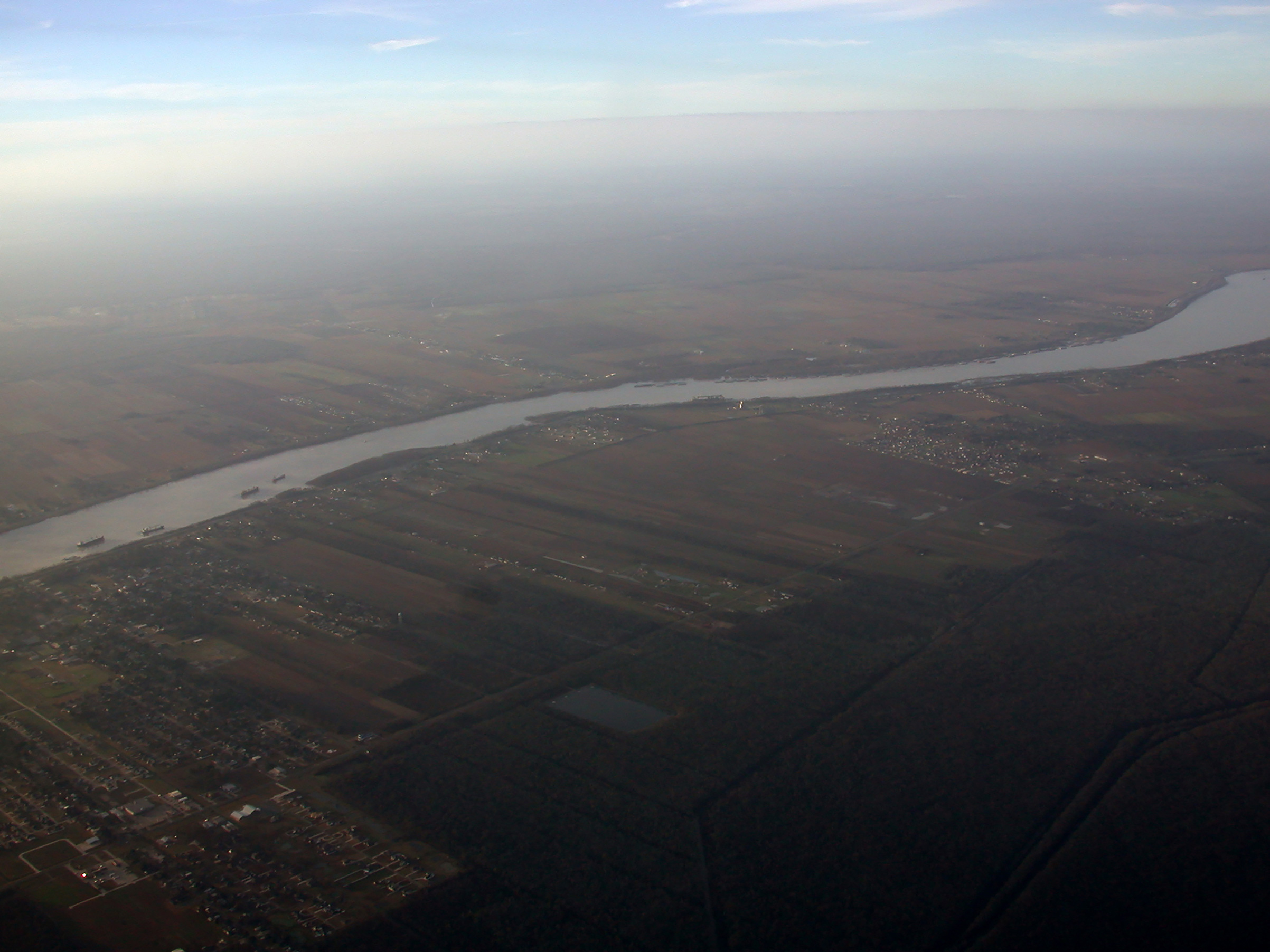 The Mississippi River, seen here north of New Orleans, feeds into the Port of South Louisiana, the largest port in the U.S. Port workers here have higher average starting salaries than workers in the tourism sector