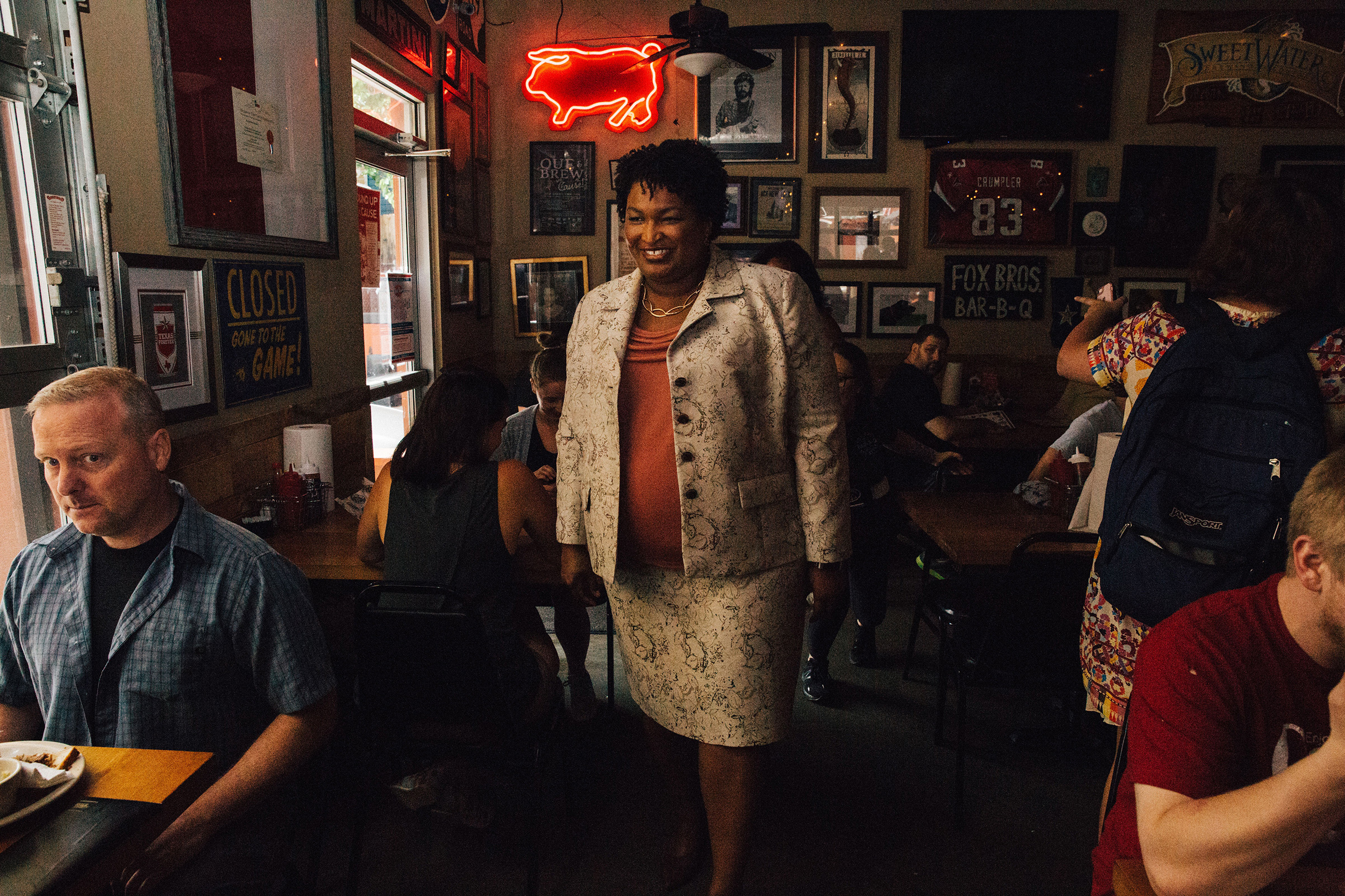 Abrams campaigns at a barbecue restaurant in Atlanta on July 2