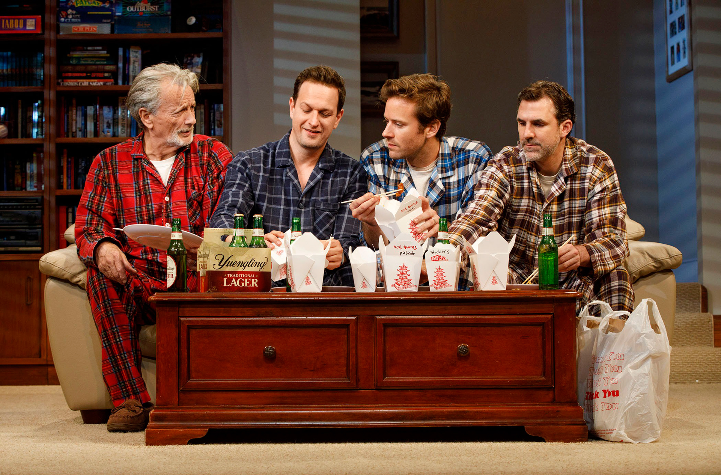 From left: Stephen Payne vies for a seat on the couch with Josh Charles, Armie Hammer and Paul Schneider. In the play, the three brothers use physical comedy to connect