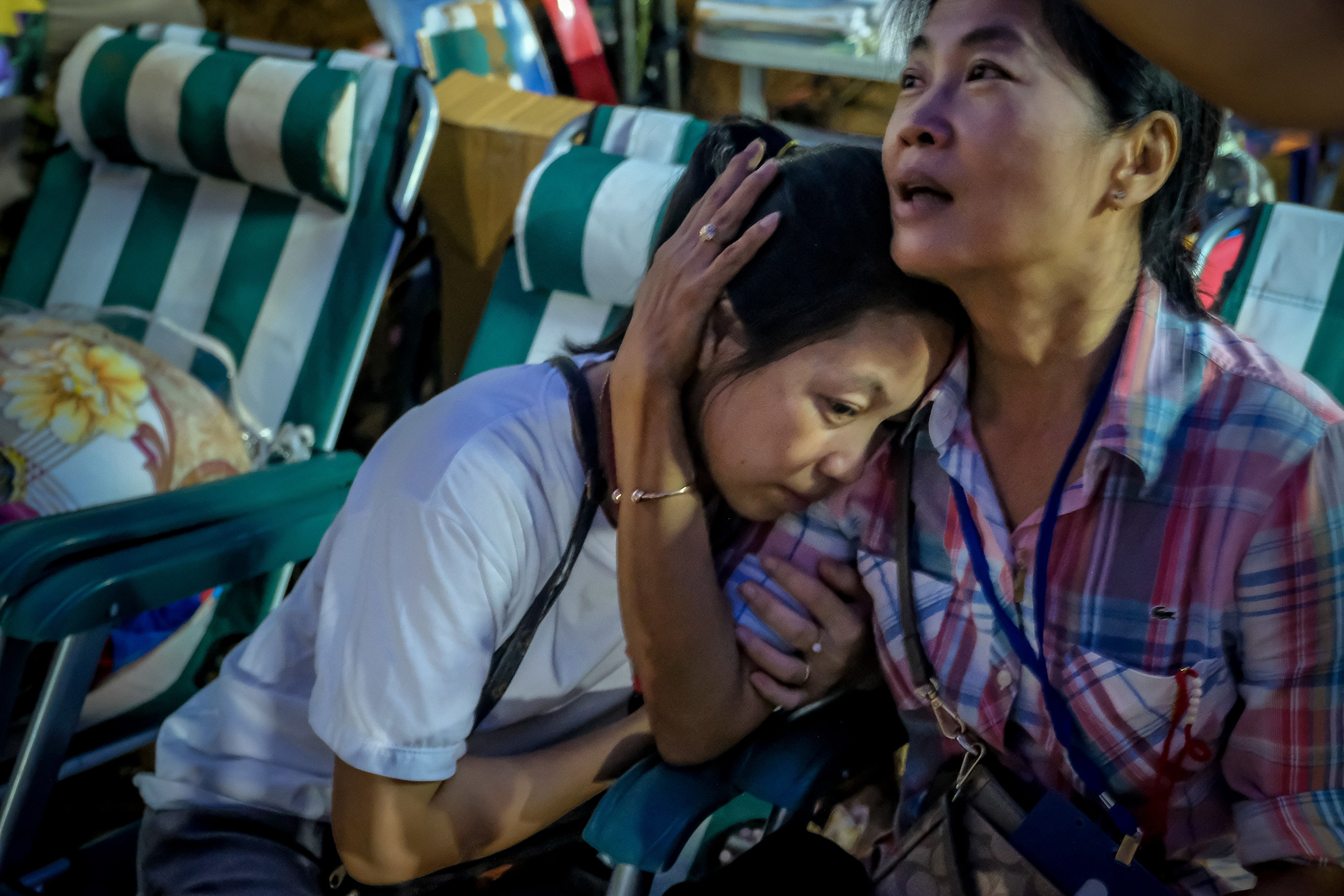 Relatives of the missing boys react after the 12 boys and their soccer coach have been found alive in the cave where they've been missing for over a week after monsoon rains blocked the main entrance on July 2, 2018 in Chiang Rai, Thailand.