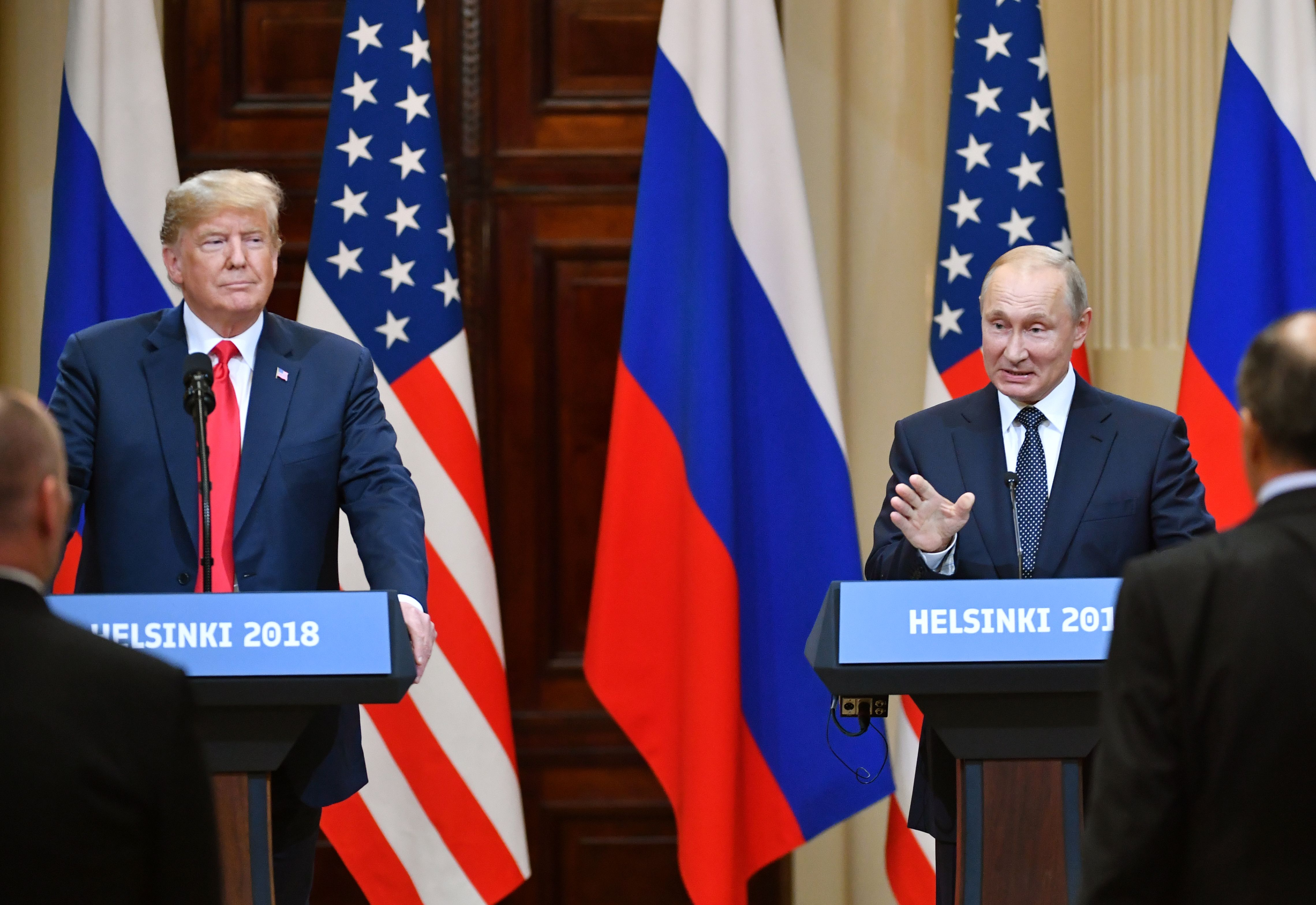 US President Donald Trump (L) and Russia's President Vladimir Putin attend a joint press conference after a meeting at the Presidential Palace in Helsinki, on July 16, 2018.