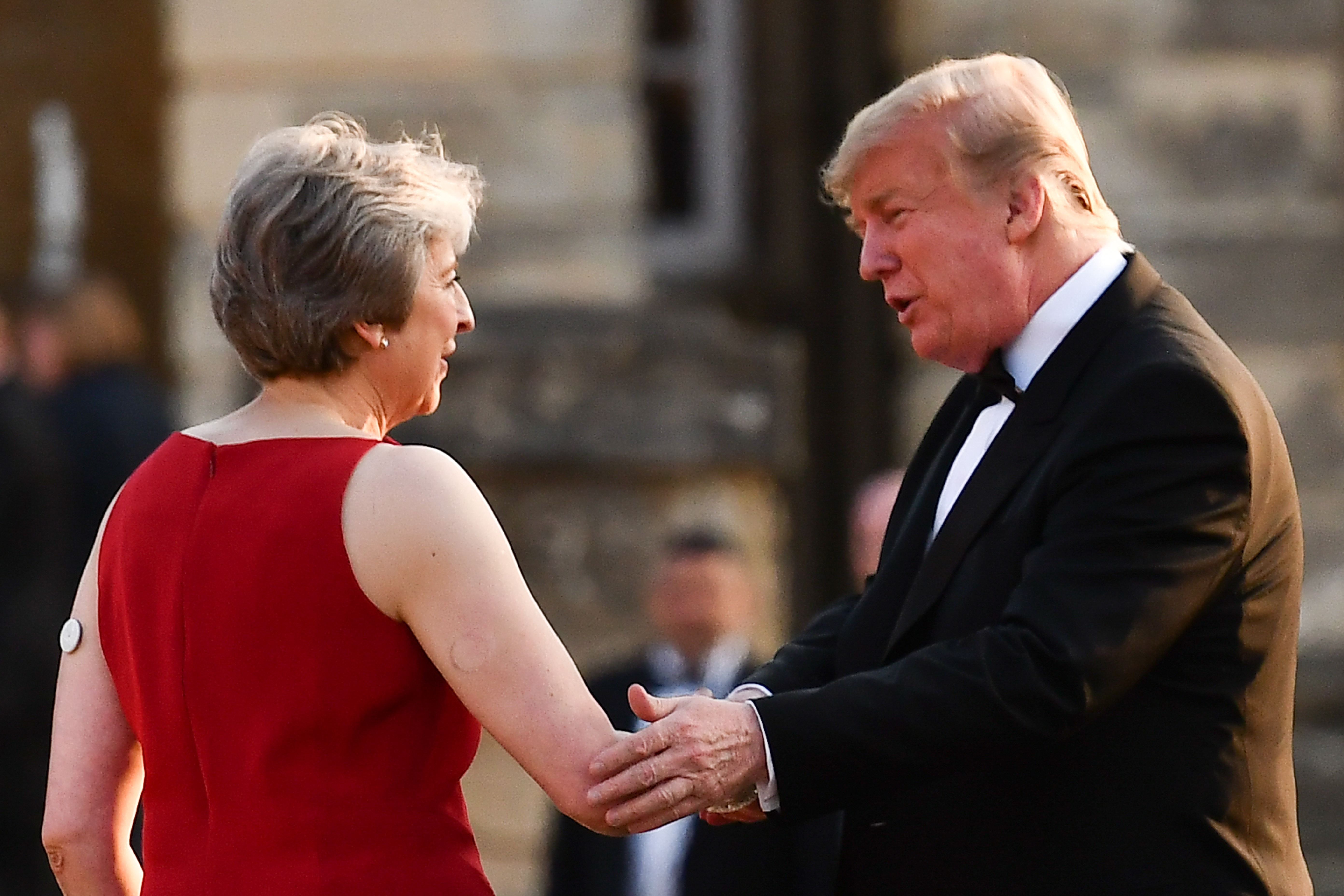 Britain's Prime Minister Theresa May greets U.S. President Donald Trump at Blenheim Palace on July 12, 2018 in Woodstock, England.