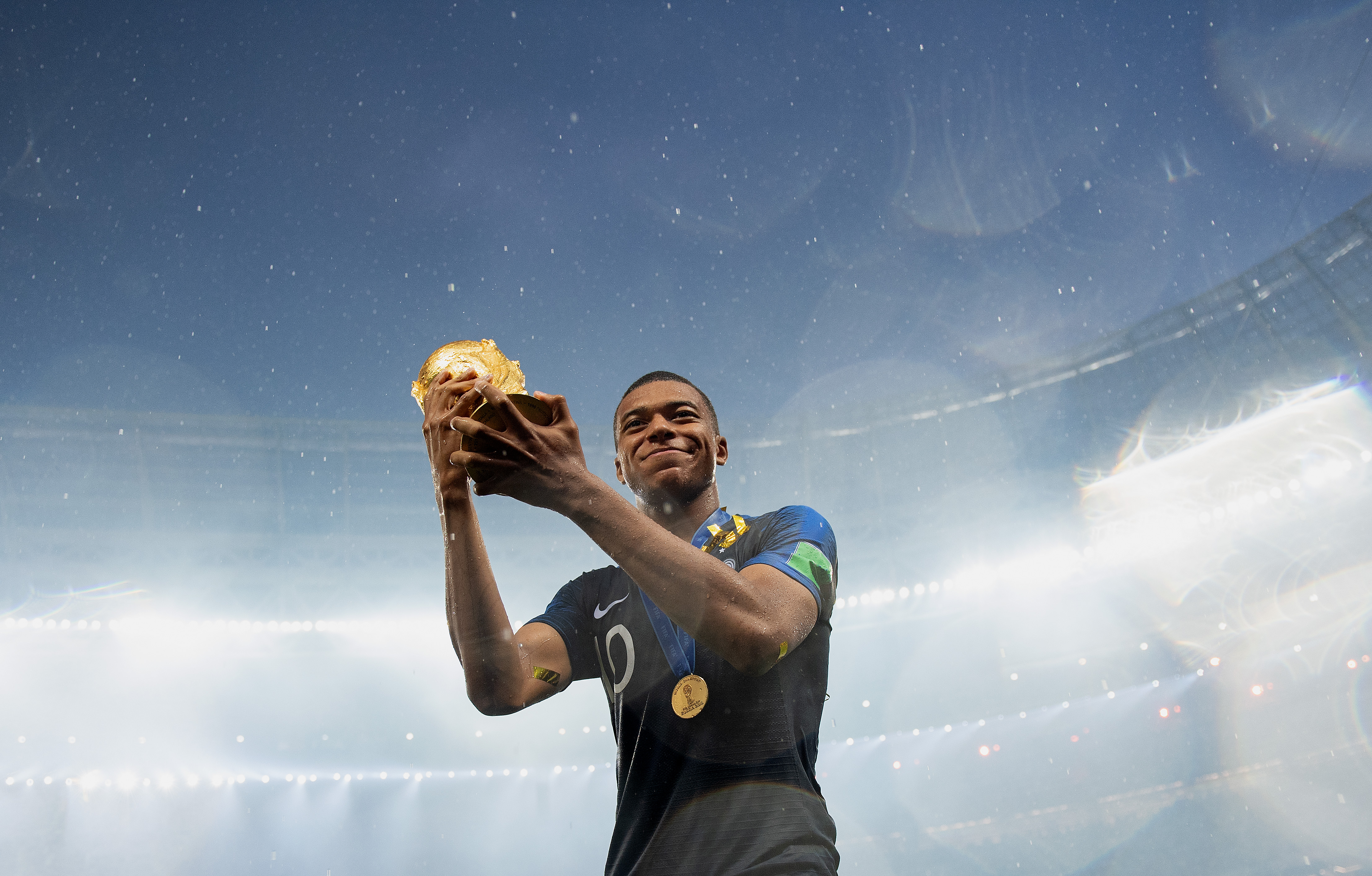 Kylian Mbappe of France celebrates with the World Cup Trophy following his sides victory in the 2018 FIFA World Cup Final between France and Croatia at Luzhniki Stadium on July 15, 2018 in Moscow, Russia.