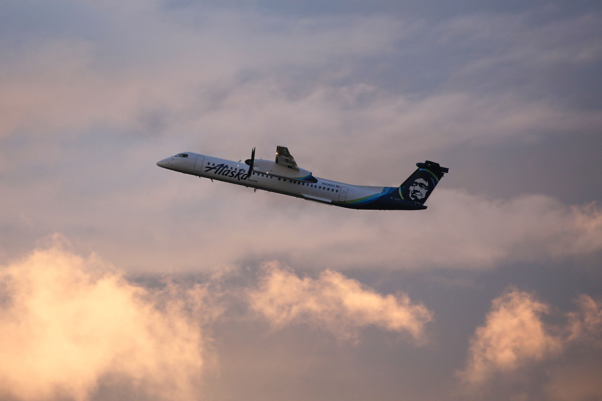 An Alaska Airlines Bombardier Dash 8 Q400 operated by Horizon Air takes off from at Seattle-Tacoma International Airport International Airport one day after Horizon Air ground crew member Richard Russell took a similar plane from the airport in Seattle, Washington on August 11, 2018.