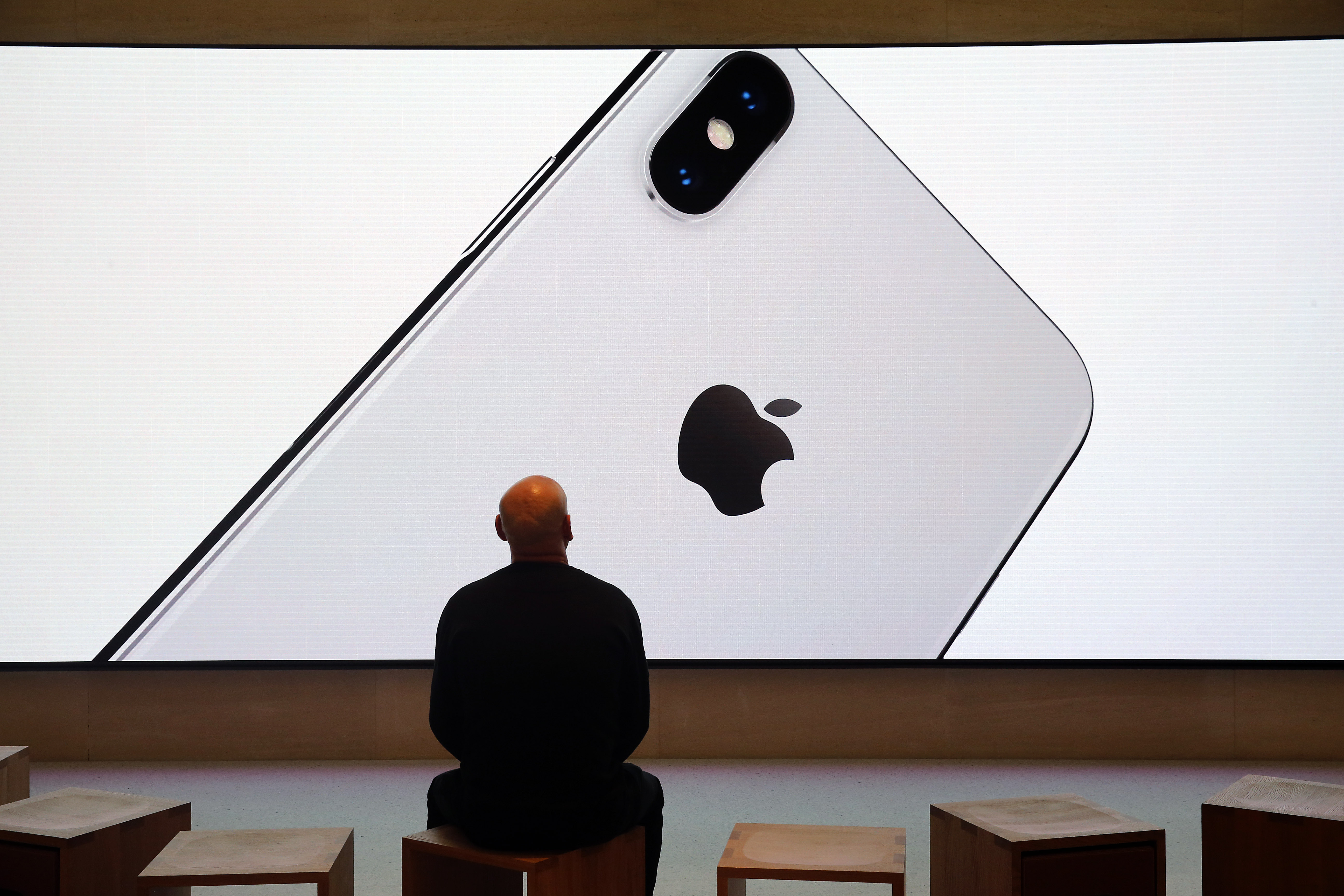 A signage for an Apple iPhone X, the new model of Apple smartphone is displayed inside the Apple Store Saint-Germain on November 3, 2017 in Paris, France.