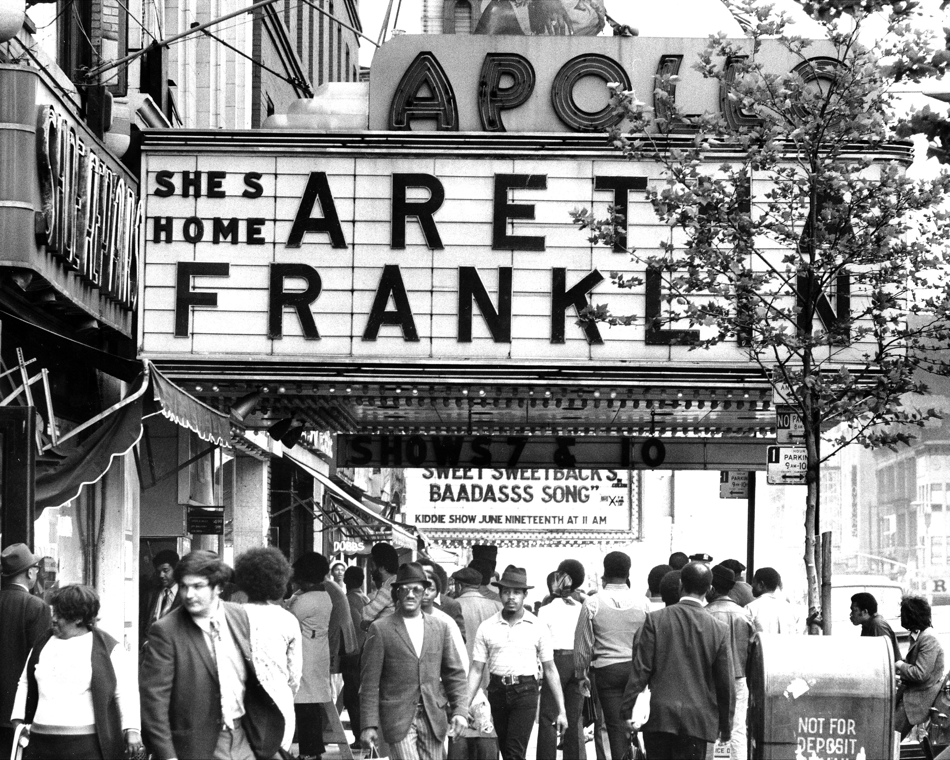 People wait on line to buy tickets to see Aretha Franklin at the Apollo Theatre in New York.