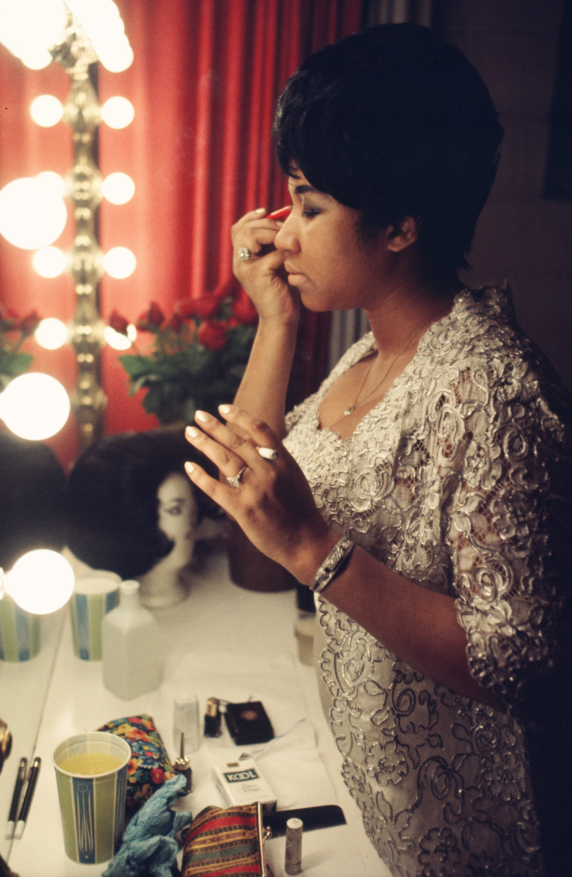 Aretha Franklin fixes her makeup backstage before a performance at Symphony Hall in 1969, Newark.