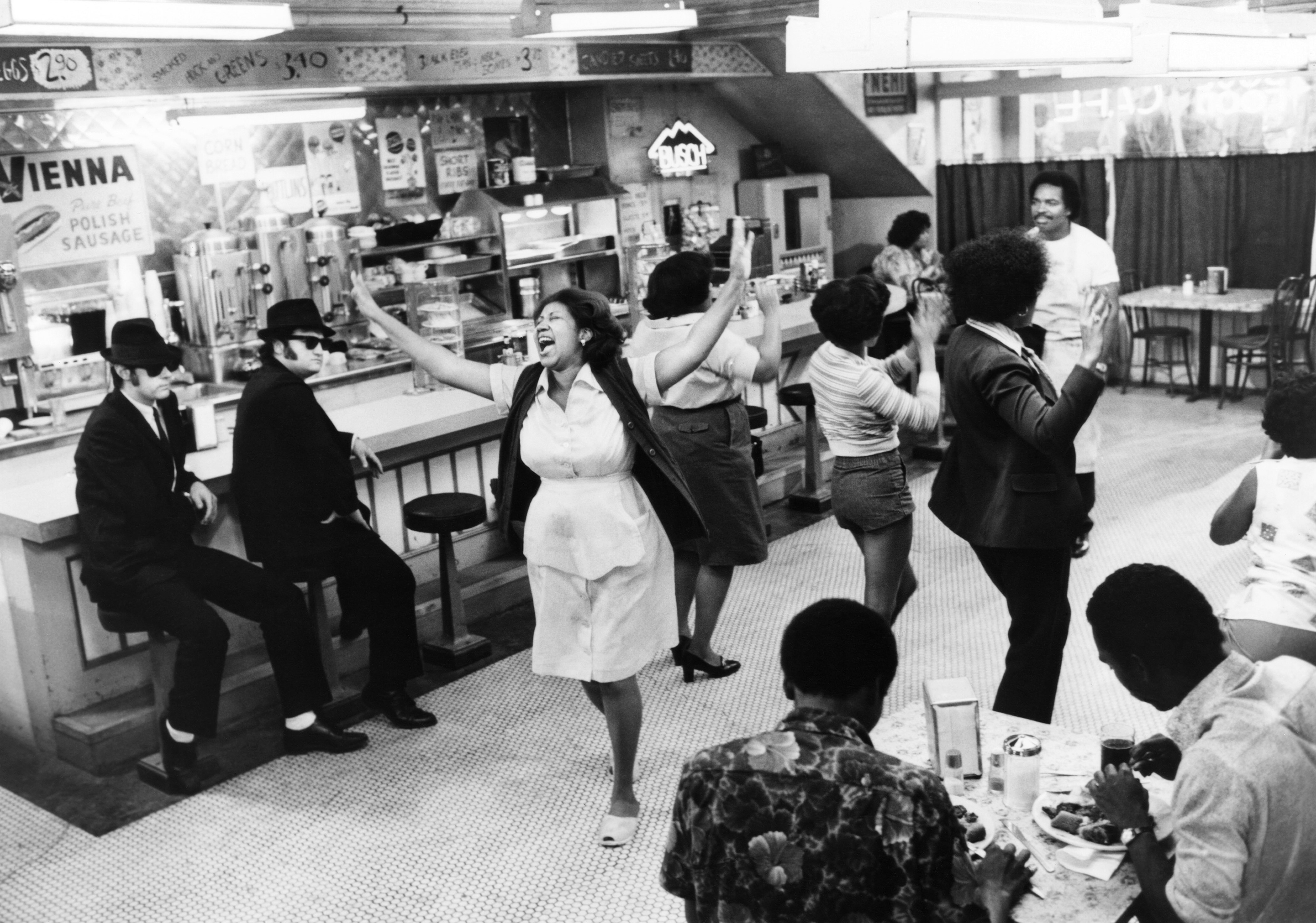 Aretha Franklin, center, lip-synchs her song Think for the 1980 film The Blues Brothers, starring Dan Aykroyd, far left, John Belushi, second left, and Matt Murphy, back right.