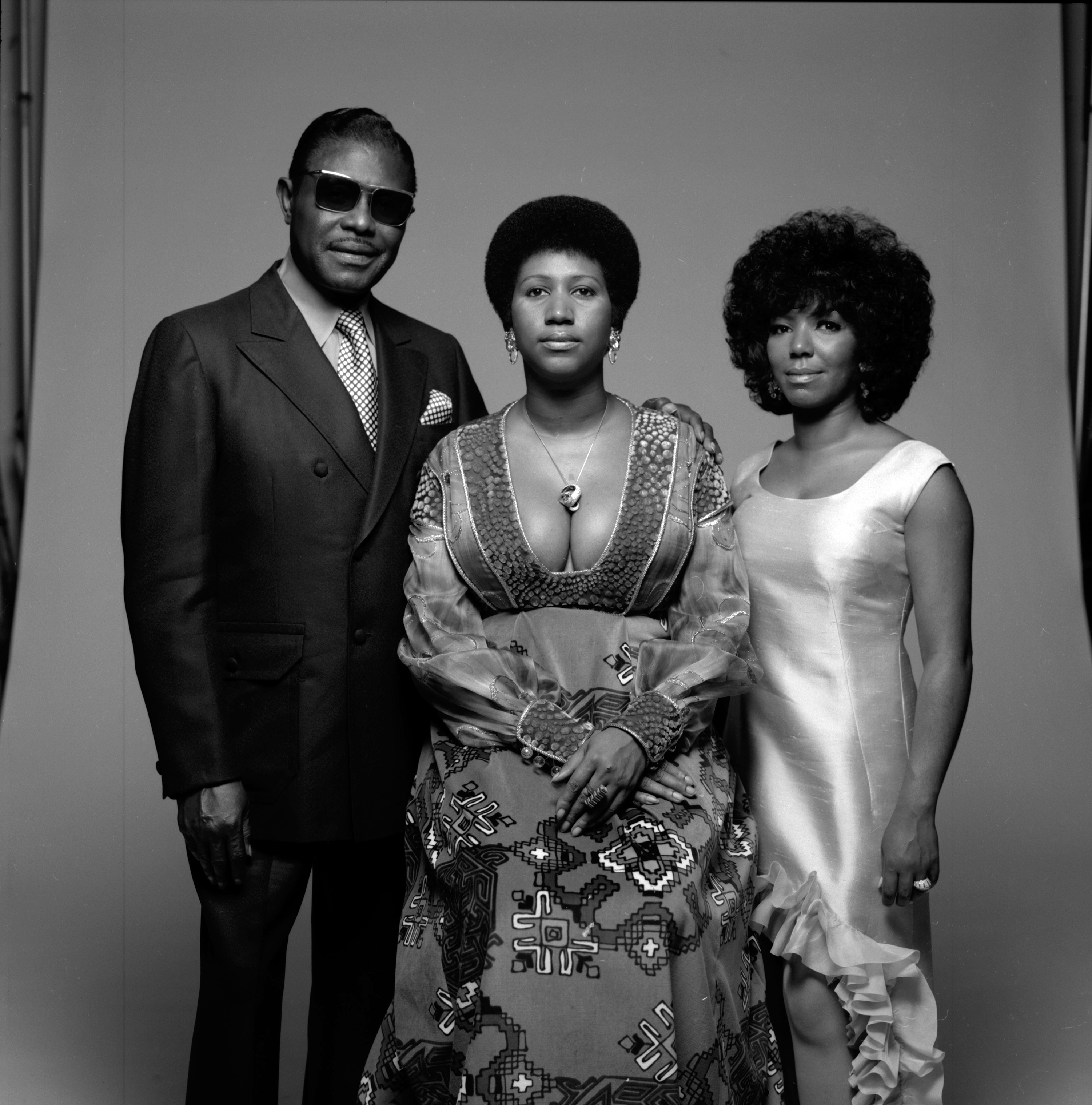 Aretha Franklin, center, her father, Reverend C. L. Franklin, and her sister, fellow singer Carolyn in New York, 1971.
