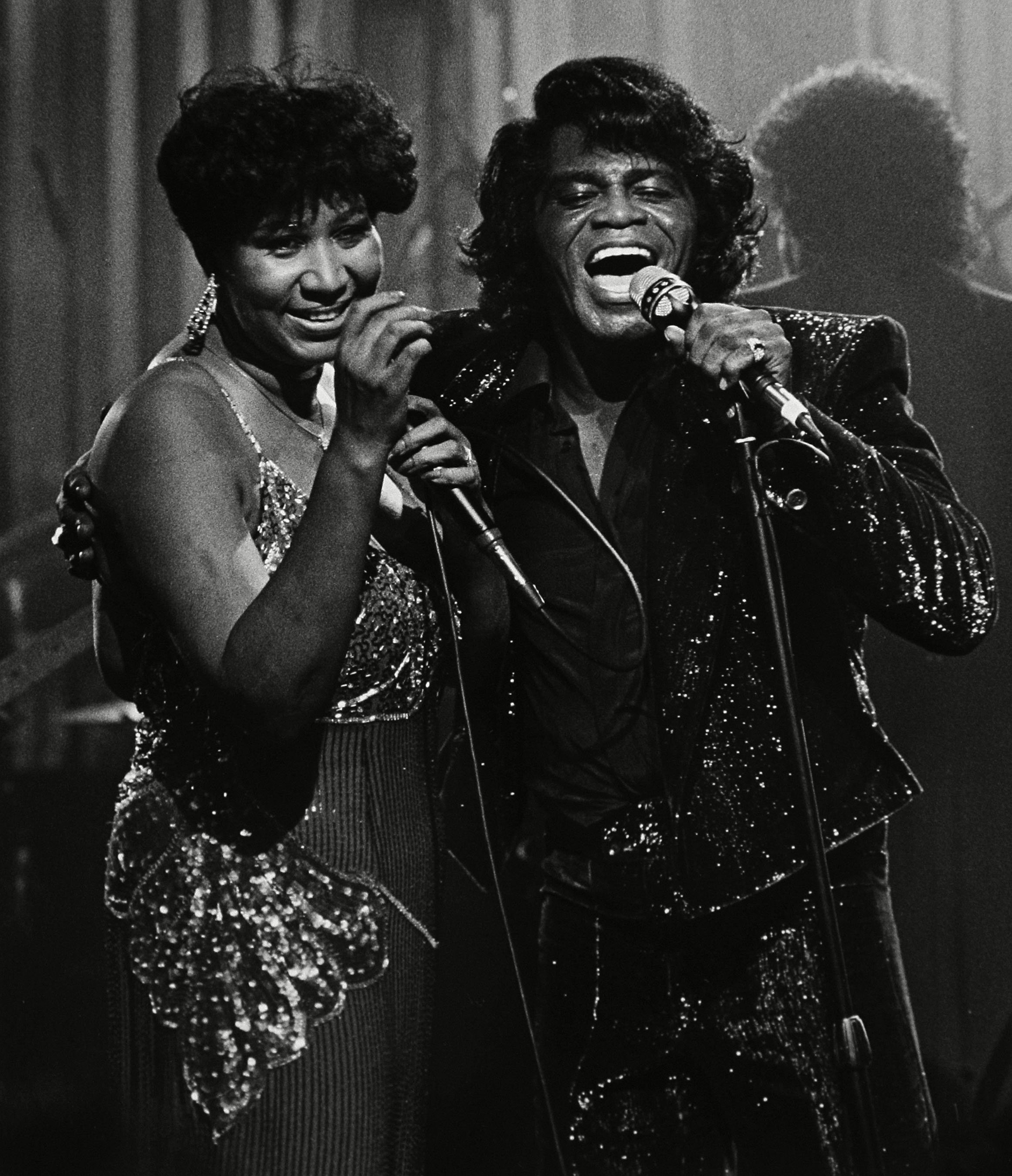 Aretha Franklin performs with James Brown during a Home Box Office taping at the Taboo night club in Detroit.