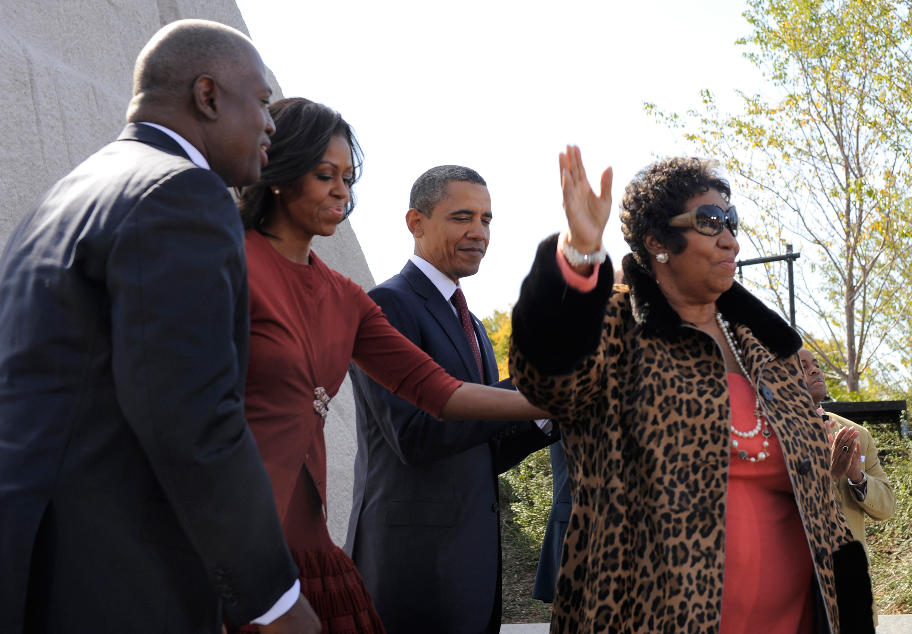 Aretha Franklin, right, finishes her performance with President Barack Obama, first lady Michelle Obama and Harry Johnson, president and CEO of the MLK National Memorial Project Fund as they attend the dedication of the Martin Luther King, Jr. Memorial on the National Mall Oct. 16, 2011 in Washington, DC.