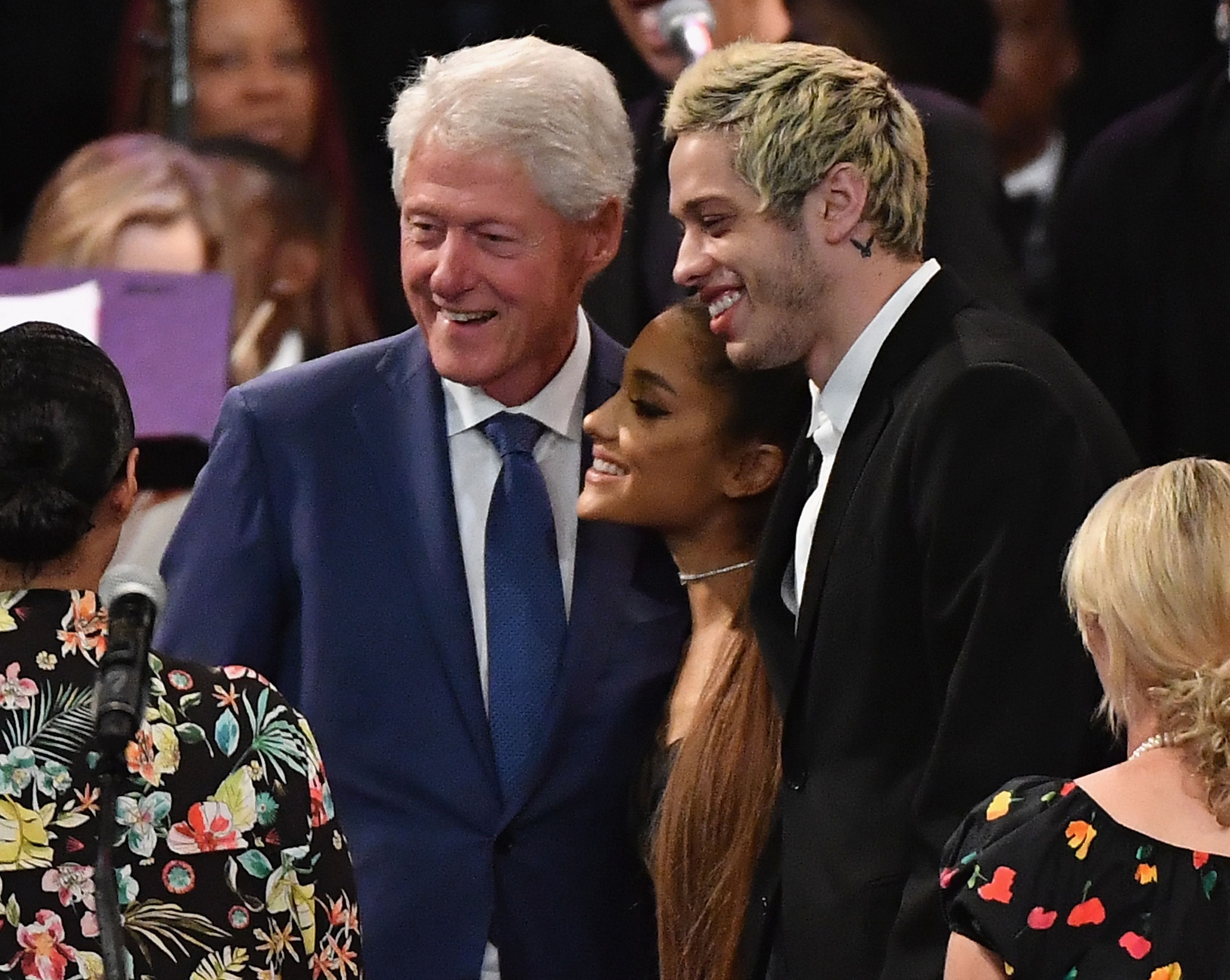 Former US President Bill Clinton takes a picture with singer Ariana Grande and her fiancee Pete Davidson at Aretha Franklin's funeral at Greater Grace Temple on August 31, 2018 in Detroit, Michigan.
