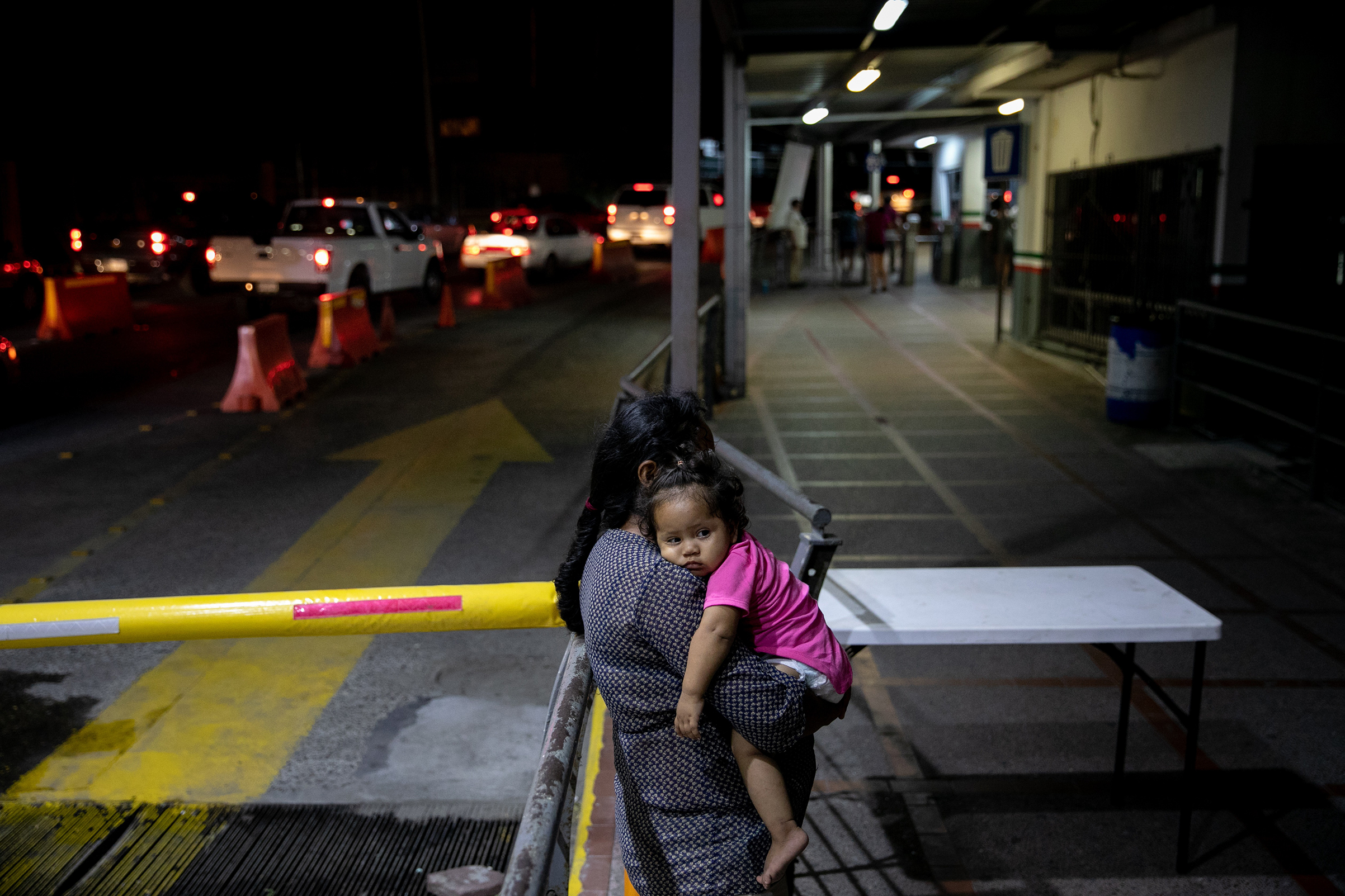 Asylum seekers at the gates to the U.S. face barriers even at official crossings like this bridge in Matamoros, Mexico