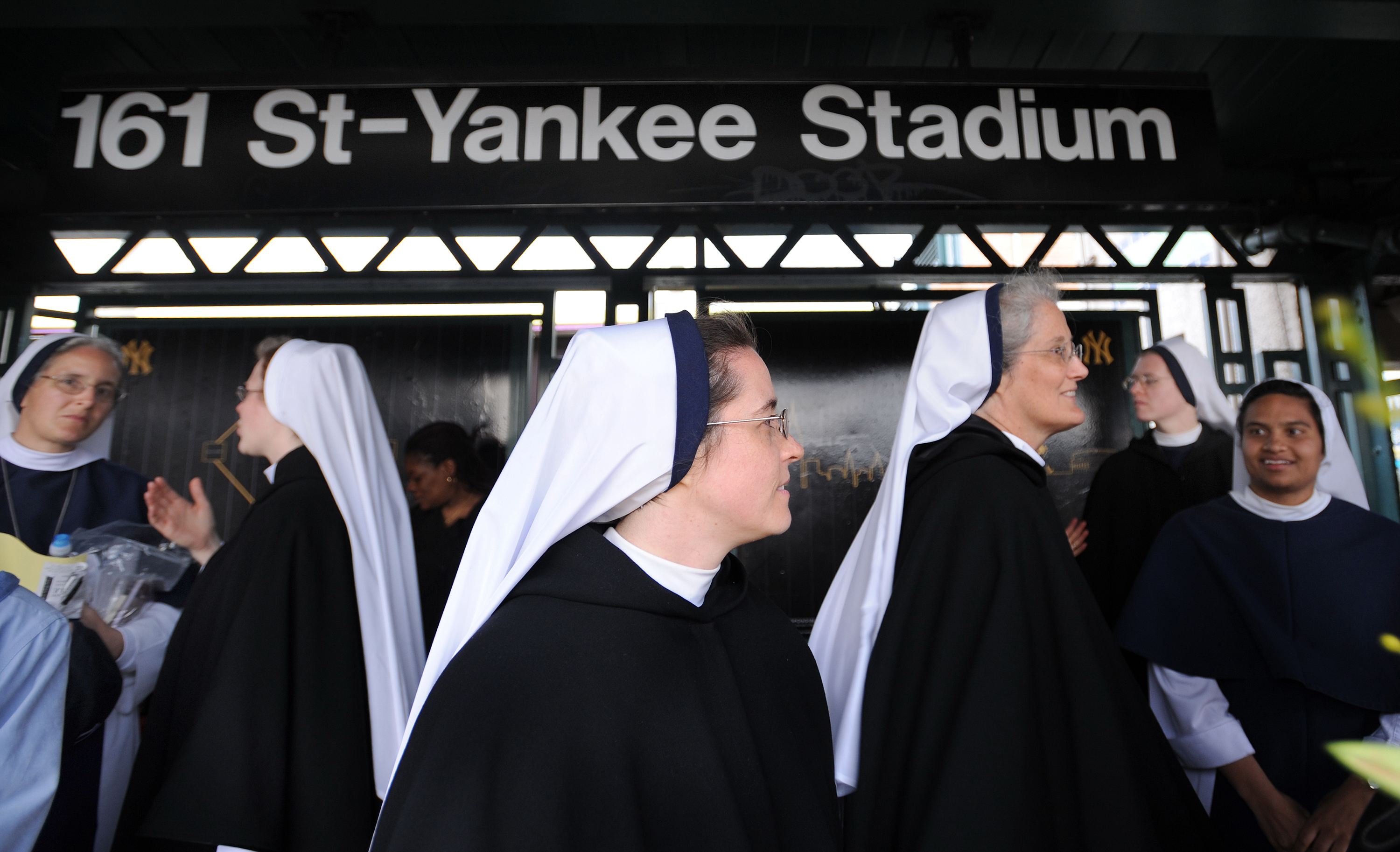 Some of the Sisters of Life nuns joined the faithful riding the 4 train home from Yankee Stadium after Pope Benedict XVI held mass at the stadium .