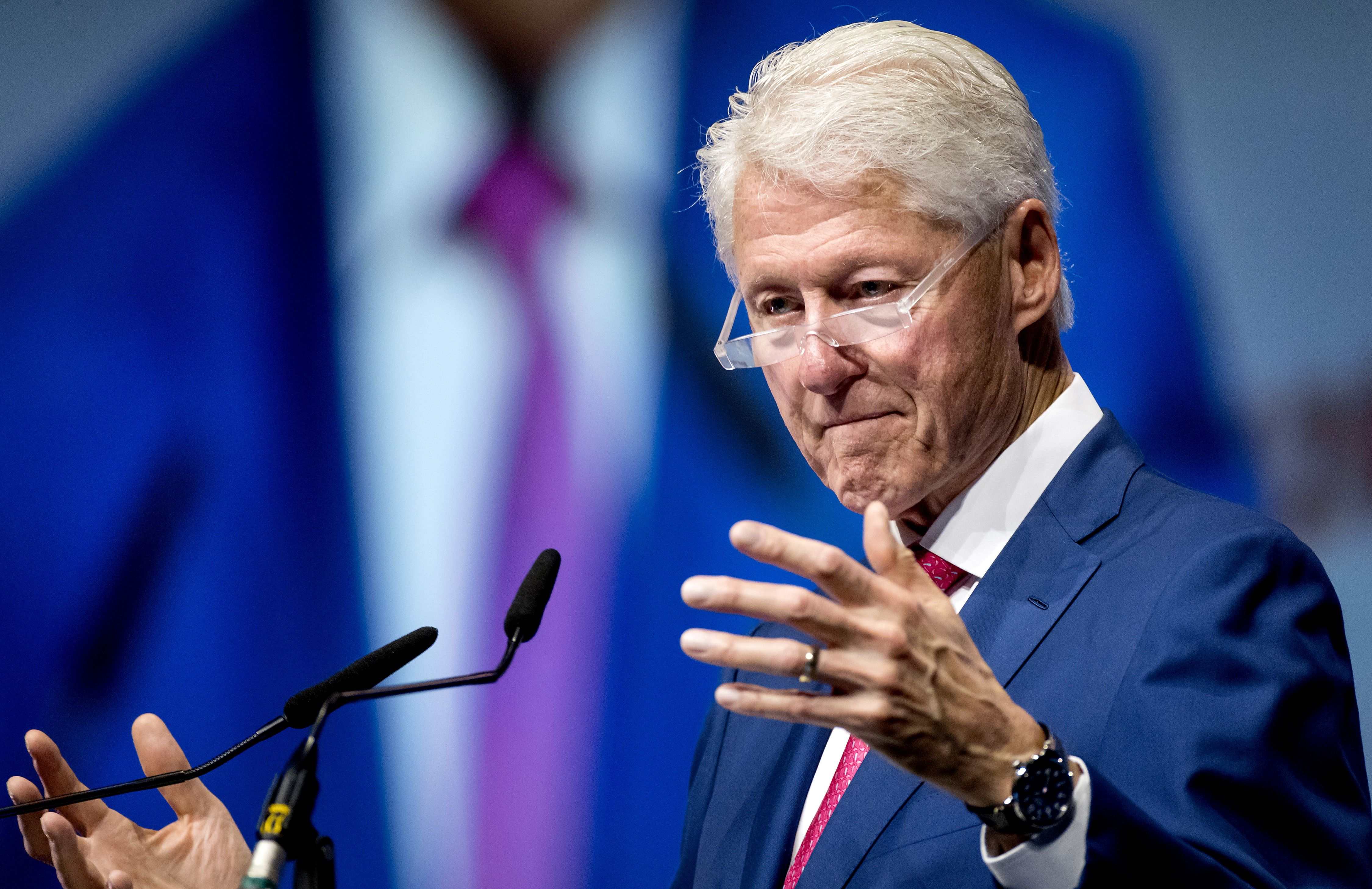 Former US President Bill Clinton speaks on the last day of the international aids conference AIDS2018 in Amsterdam on July 27, 2018. - Thousands of experts, scientists, politicians, policy makers and activists gathered for the conference on hiv and aids.