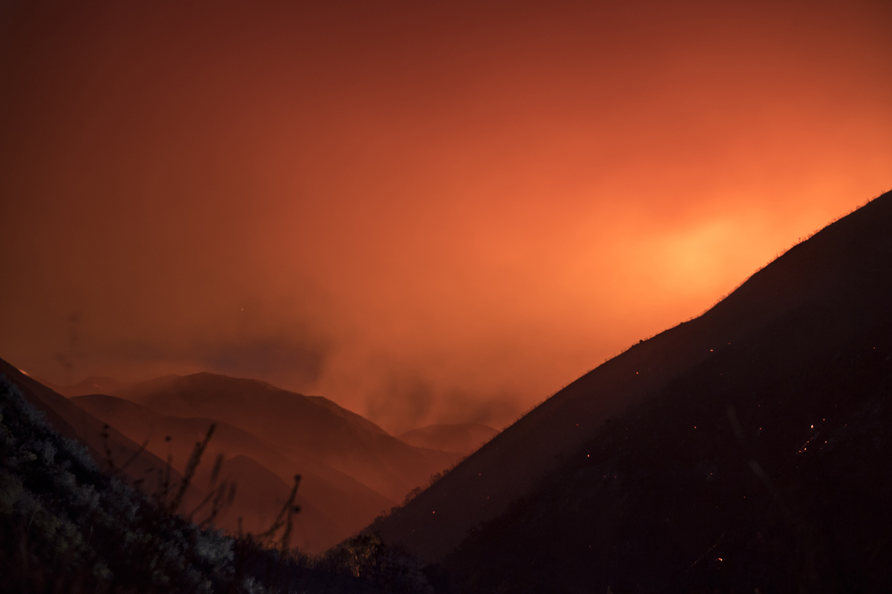 The night sky turns orange as Holy Jim Canyon smolders on Aug 6.