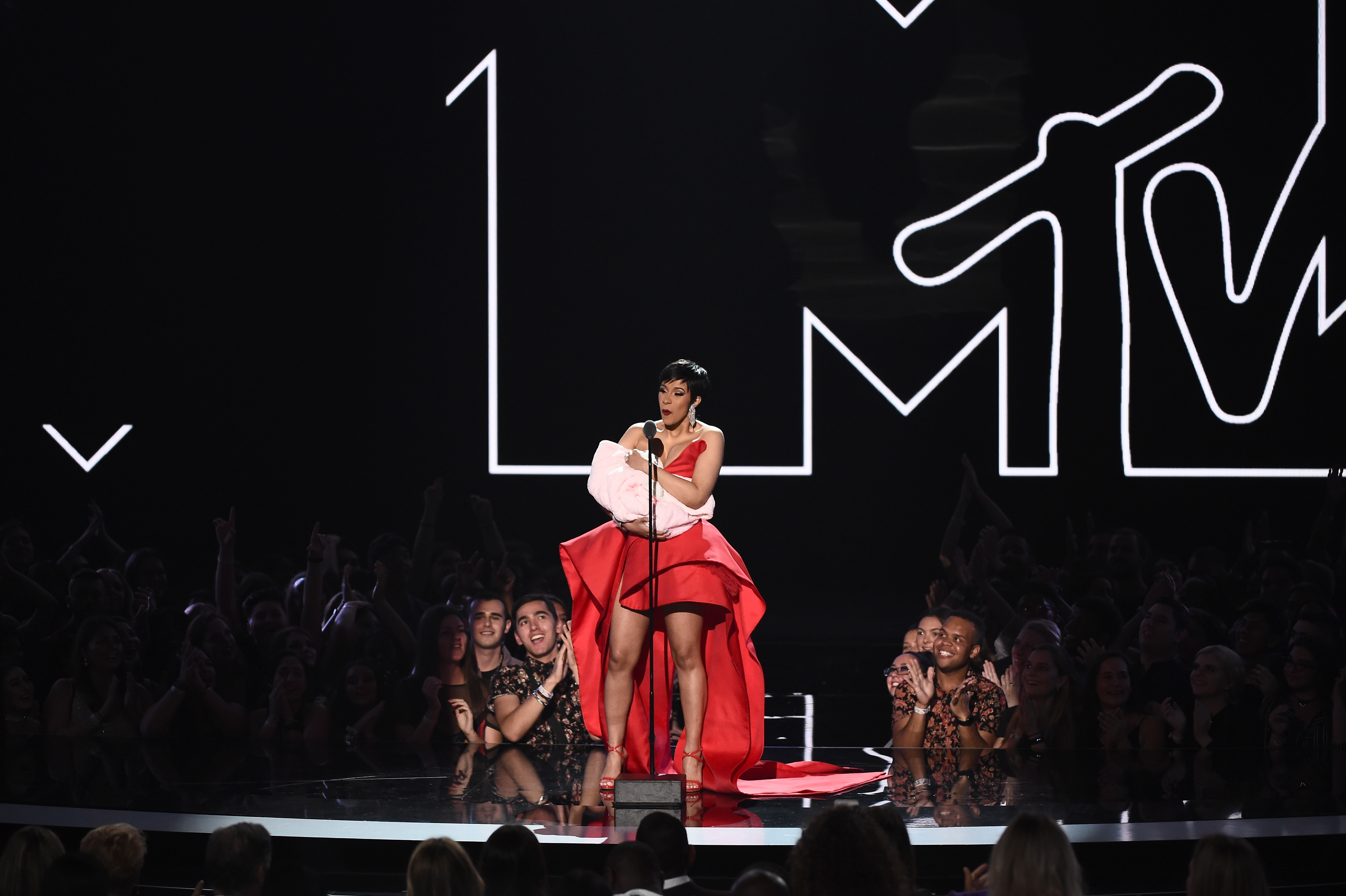 Cardi B speaks onstage during the 2018 MTV Video Music Awards at Radio City Music Hall on August 20, 2018 in New York City.  (Photo by Michael Loccisano/Getty Images for MTV)