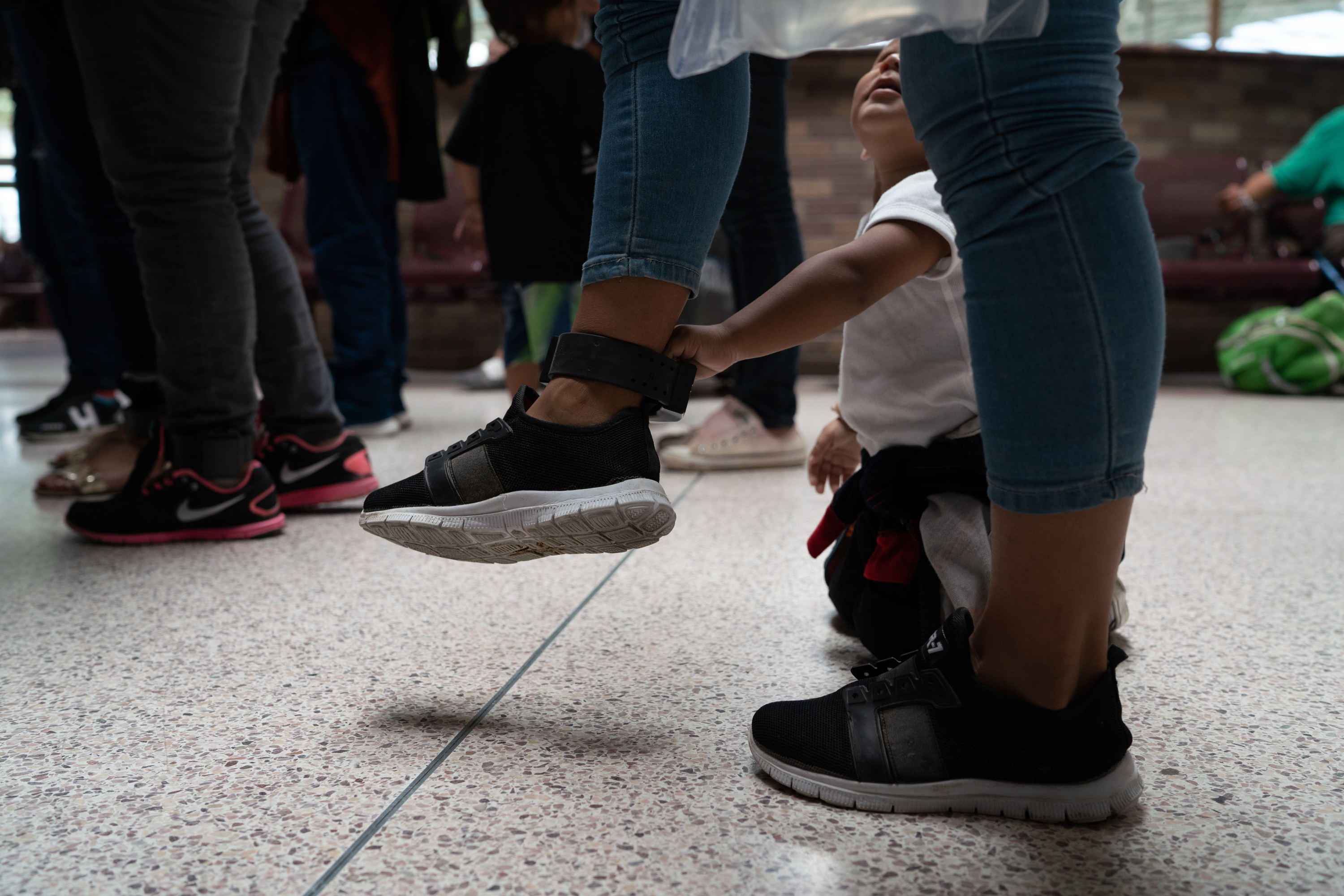 Central American asylum seekers wait at the bus station in McAllen to be taken to the Catholic Charities Humanitarian Respite Center on Aug. 2, 2018.