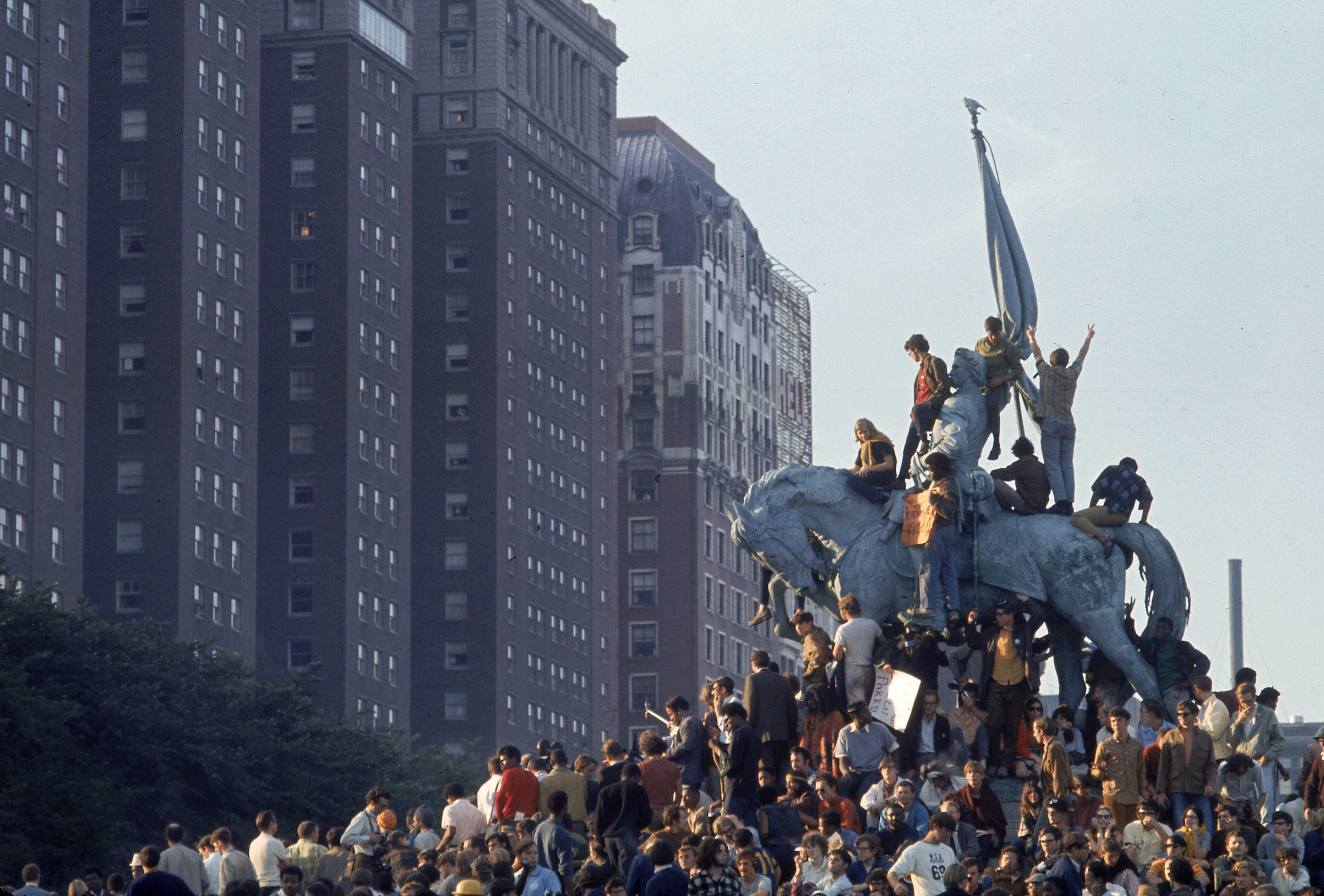 Yippie demonstrators swarming a statue in Grant Park during the 1968 Democratic National Convention.