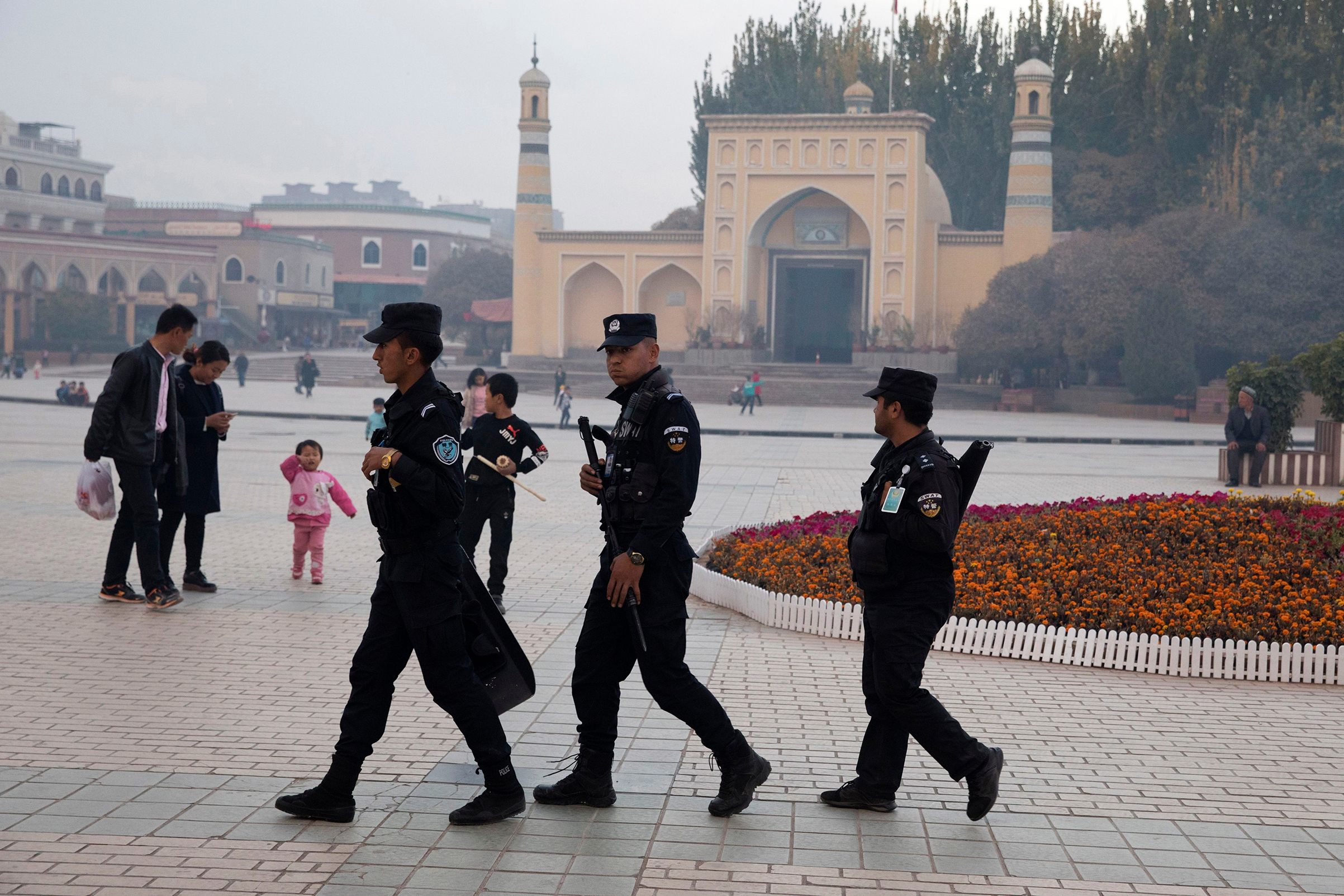 Security personnel patrol near the Id Kah Mosque in western China's Xinjiang region on Nov. 4