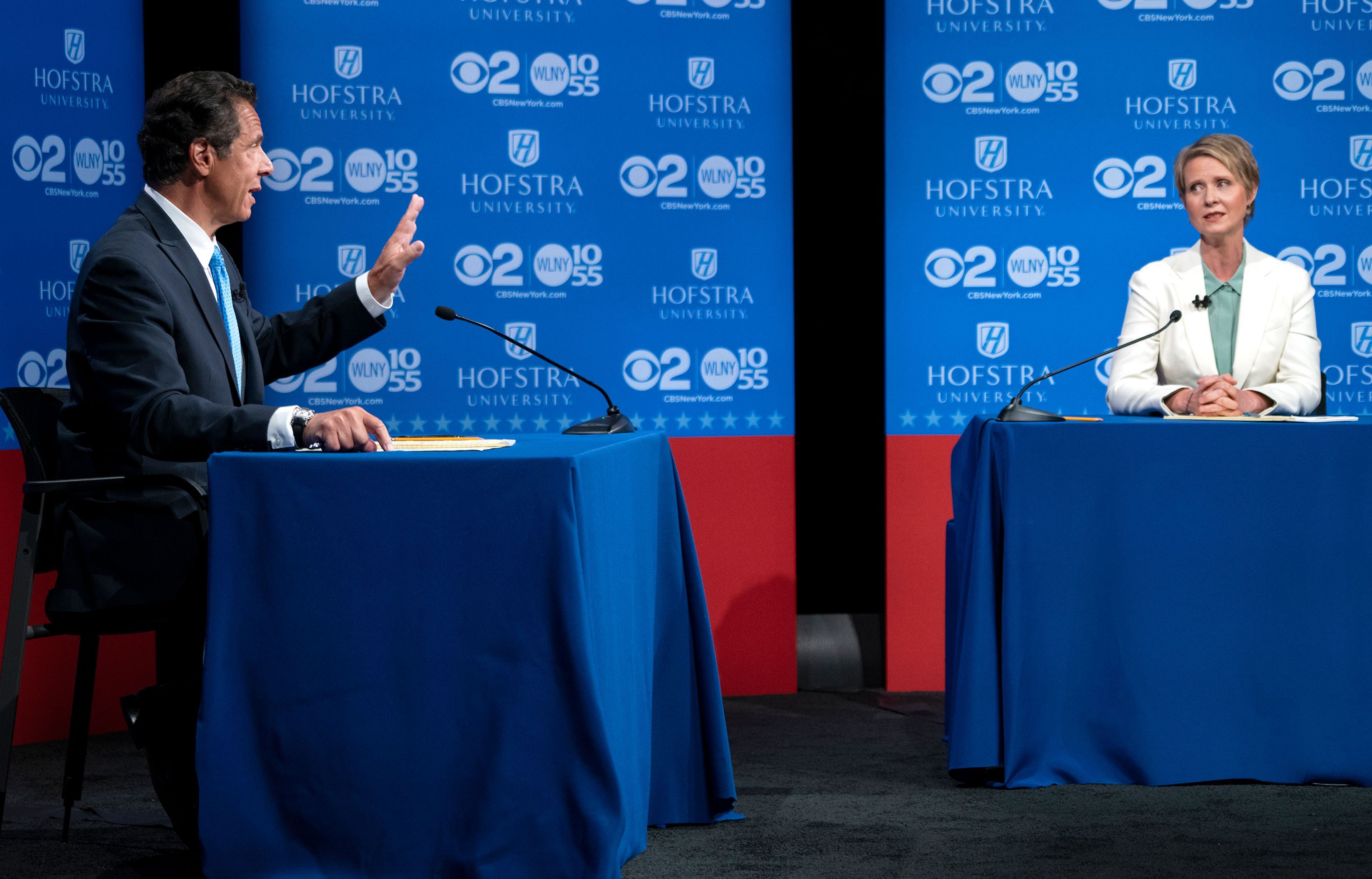 New York Governor Andrew Cuomo answers a question as  Democratic New York gubernatorial candidate Cynthia Nixon looks on during a gubernatorial debate at Hofstra University in Hempstead, New York, on August 29, 2018.