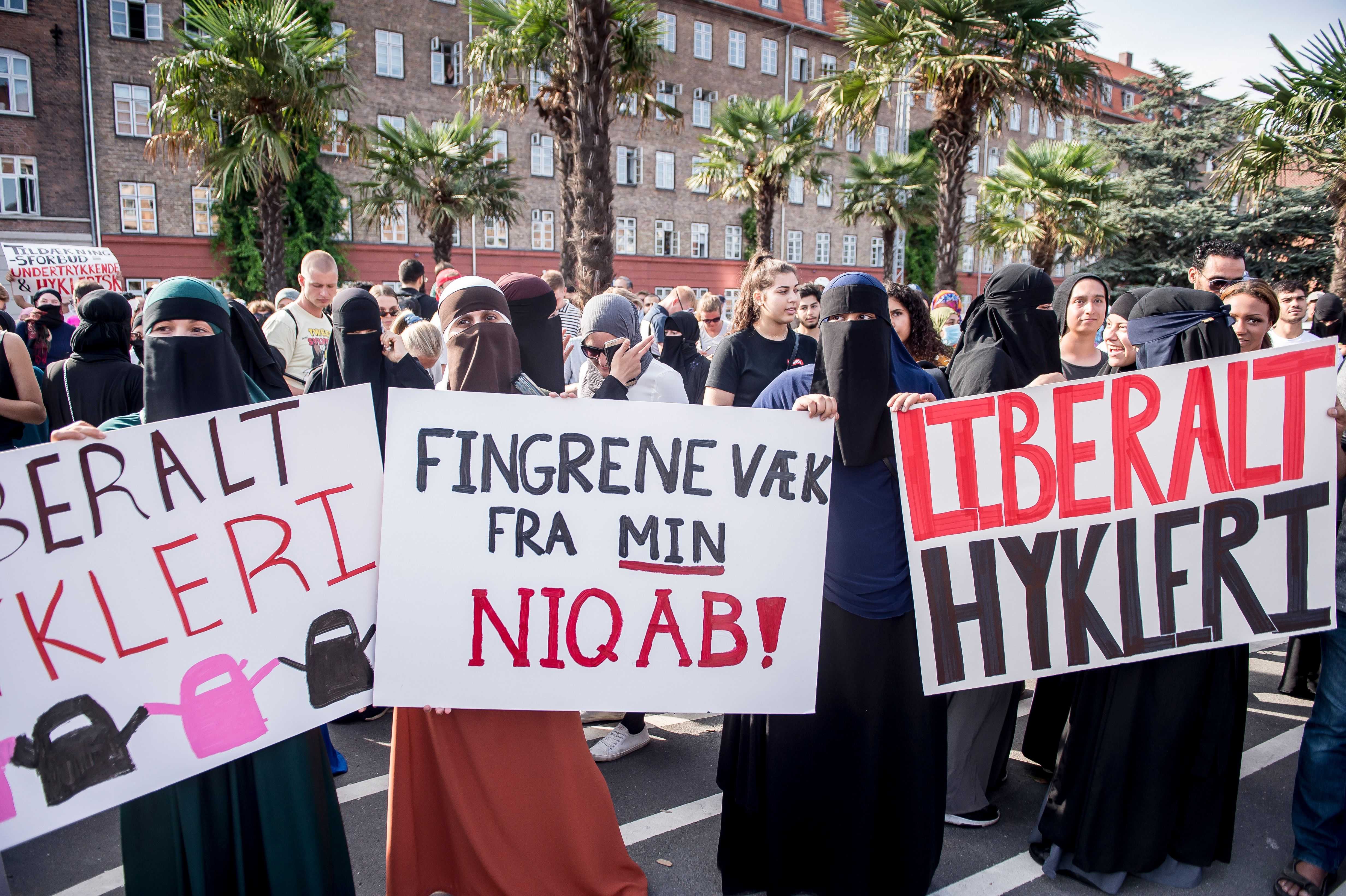 Women wearing niqabs to veil their faces take part in a demonstration on August 1, 2018, the first day of the implementation of the Danish face veil ban, in Copenhagen, Denmark.