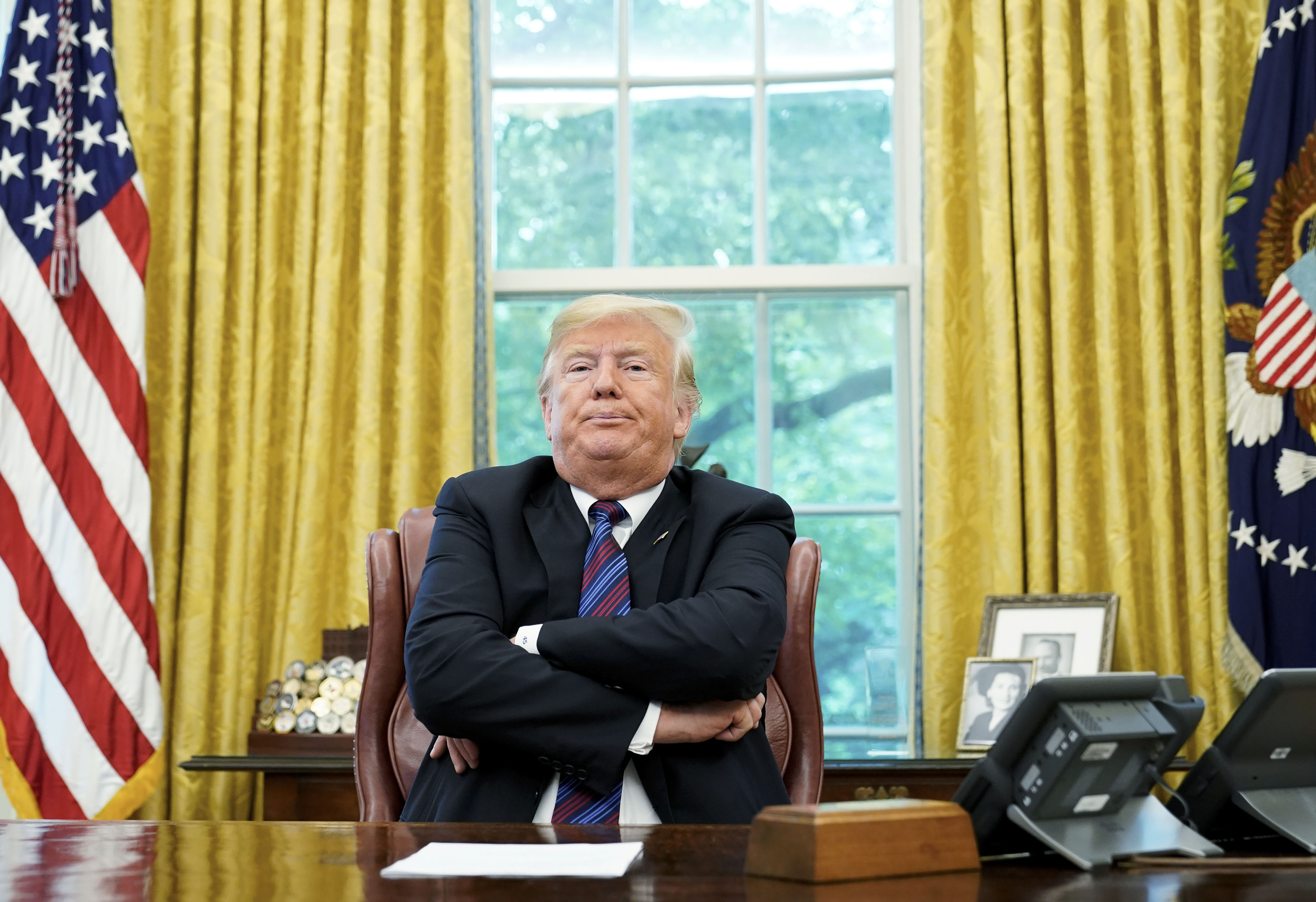 US President Donald Trump speaks to reporters after a phone conversation with Mexico's President Enrique Pena Nieto on trade in the Oval Office of the White House on Aug. 27