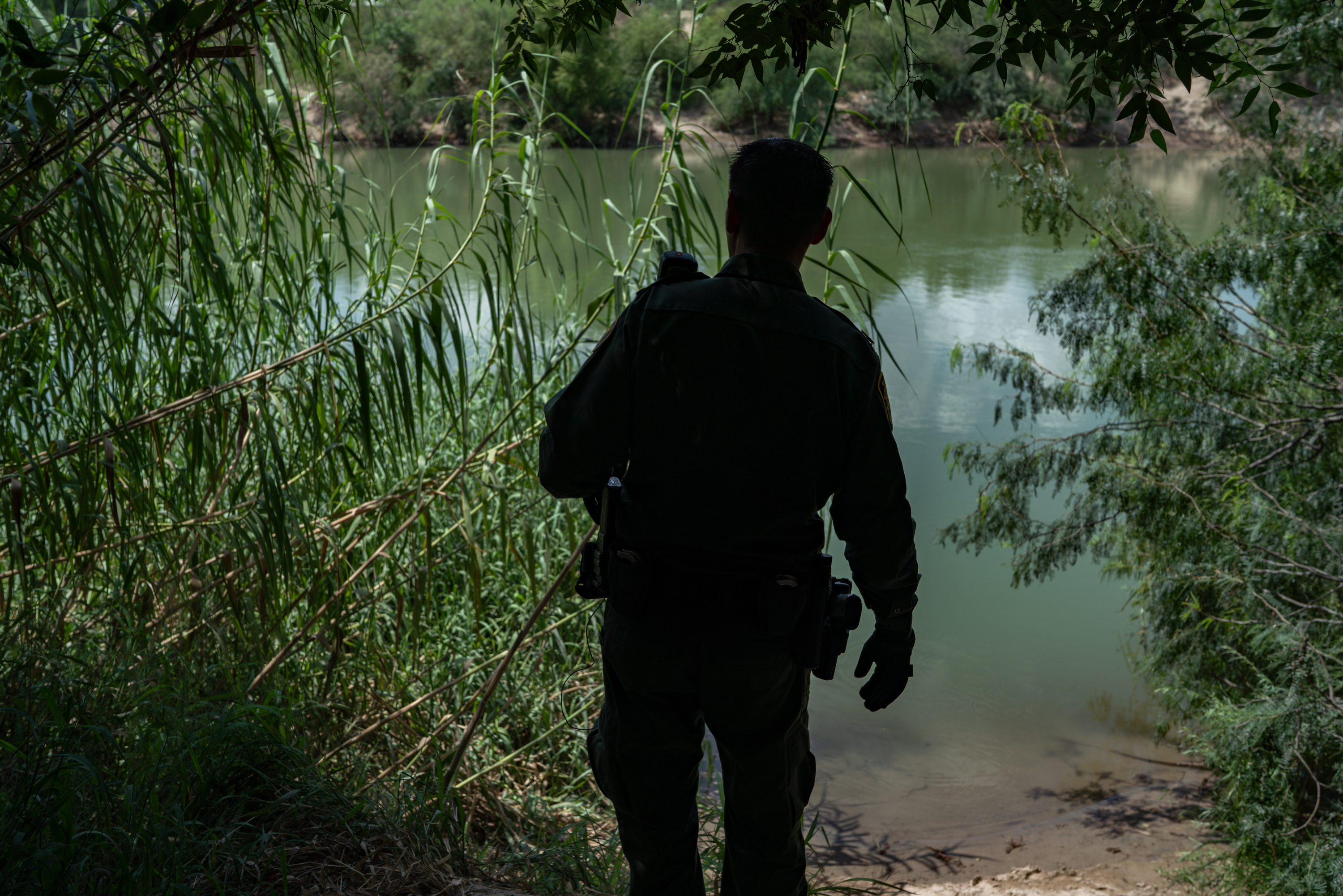 On U.S. soil a short boat ride from Mexico, Border Patrol agent Robert RodrÌguez, 38, checks a common landing area for people crossing the Rio Grande.