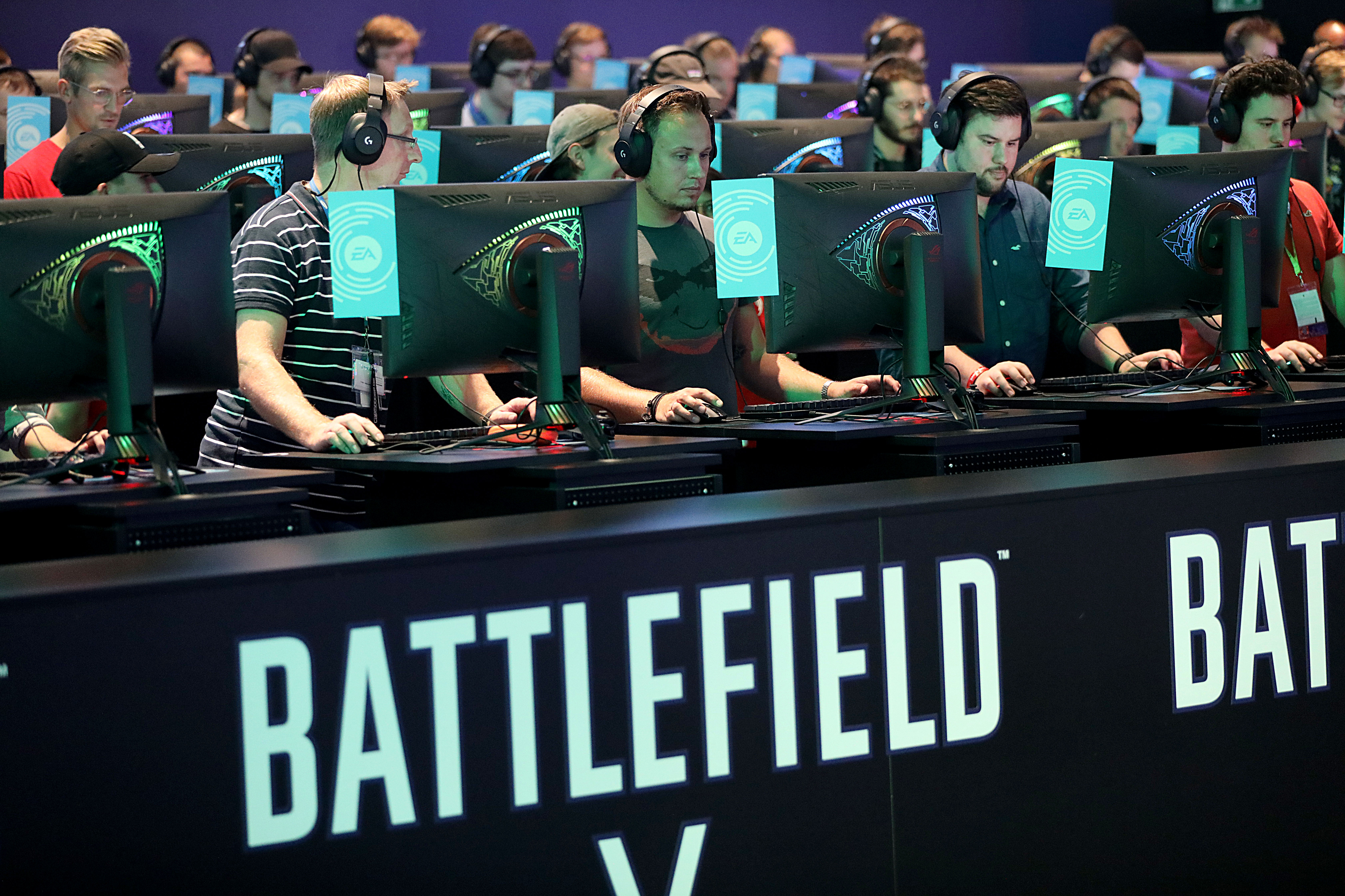 Visitors of Gamescom play at the stand of Electronic Arts  Battlefield  in Cologne, Germany on Aug. 21, 2018.