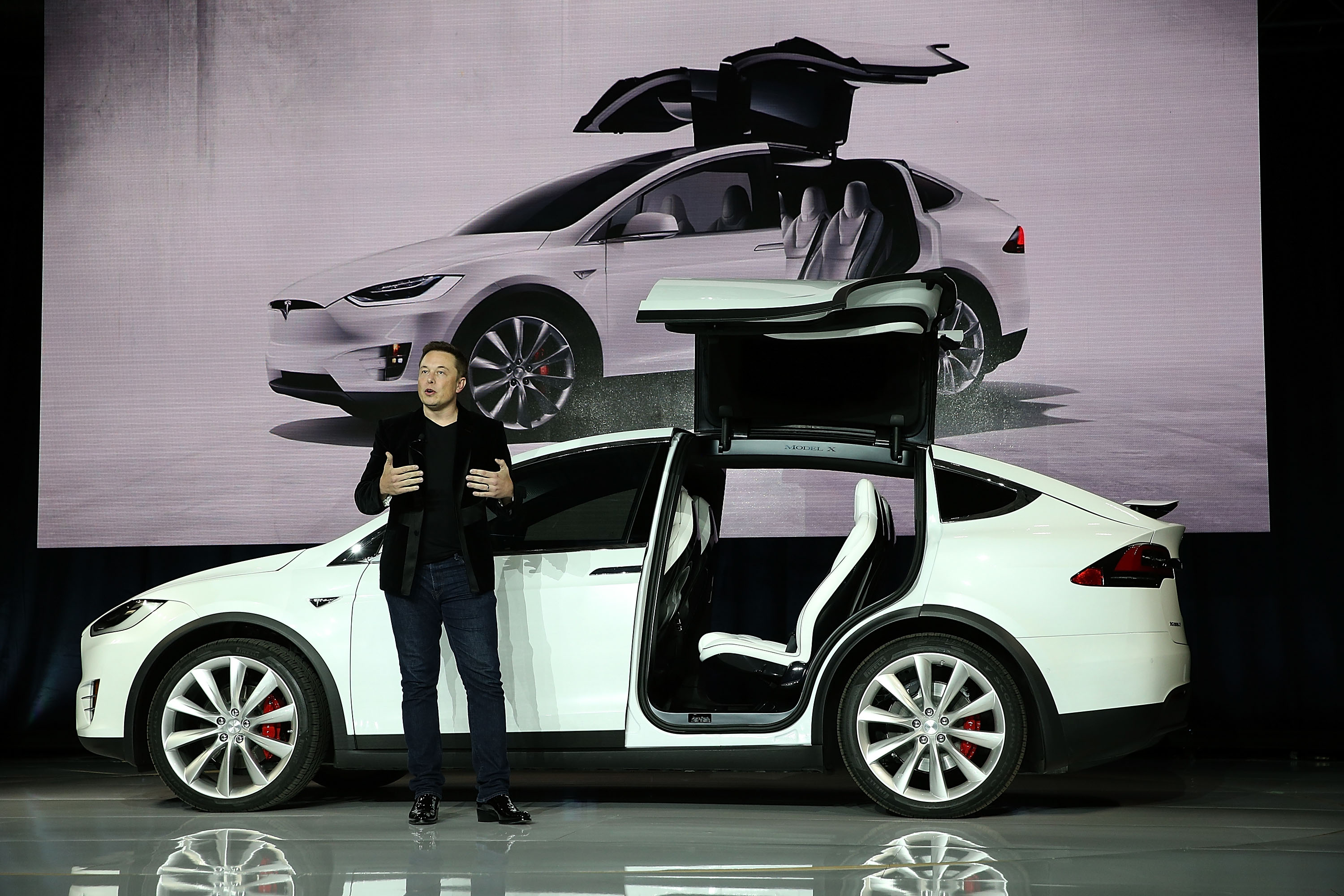 In this file photo, Tesla CEO Elon Musk speaks during an event to launch the new Tesla Model X Crossover SUV on September 29, 2015 in Fremont, California. Musk announced on Tuesday that he is considering taking the company private, valuing it at $82 billion.