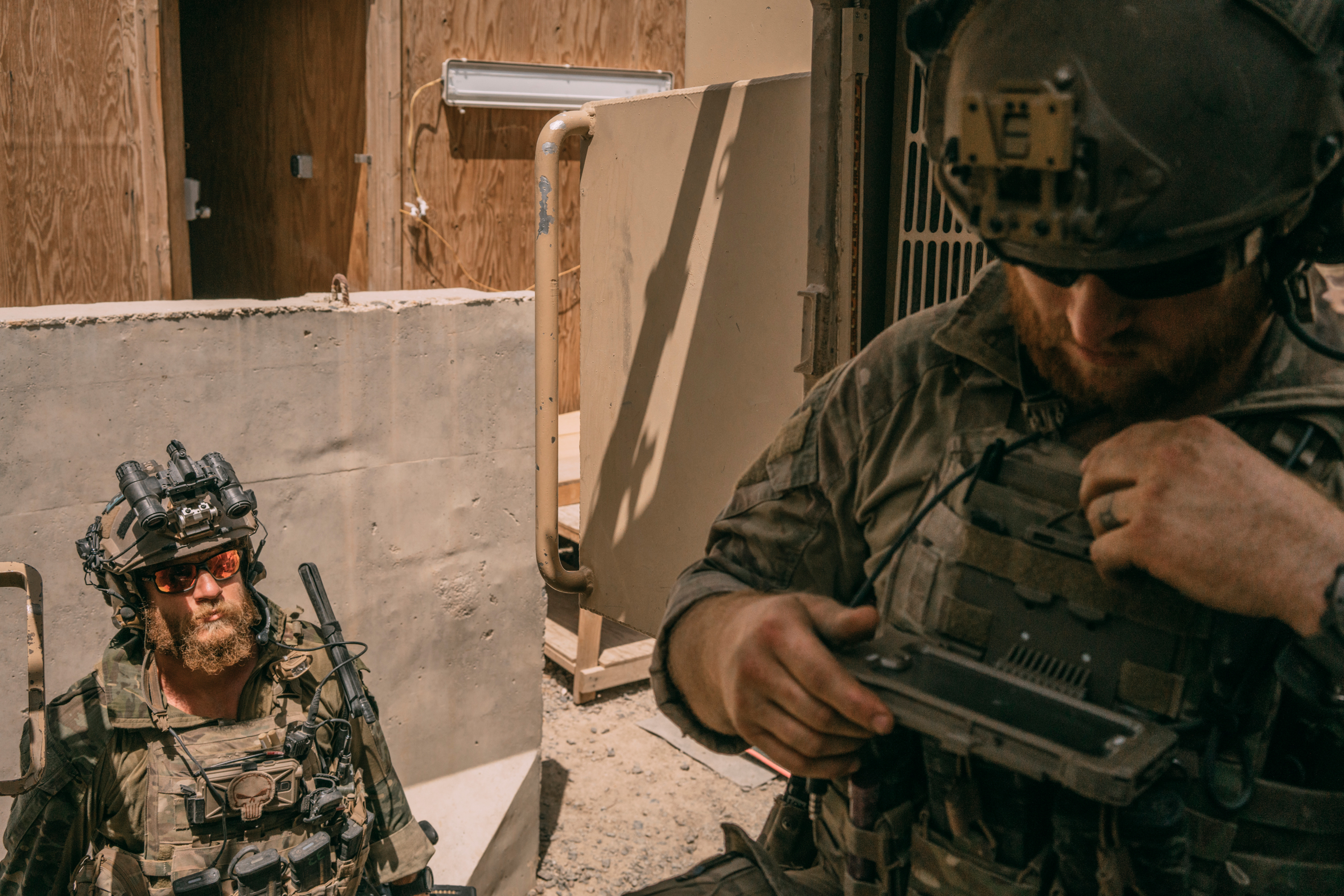A Green Beret, left, and a Special Tactics airman prepare to move toward Ghazni from a makeshift outpost on Aug. 16.