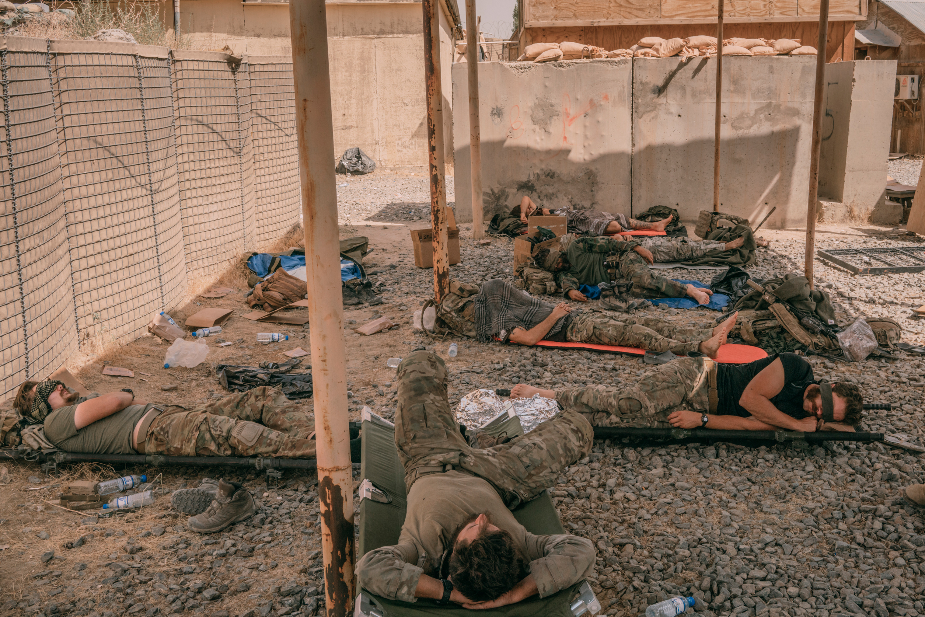Special Forces soldiers sleep at a military outpost.