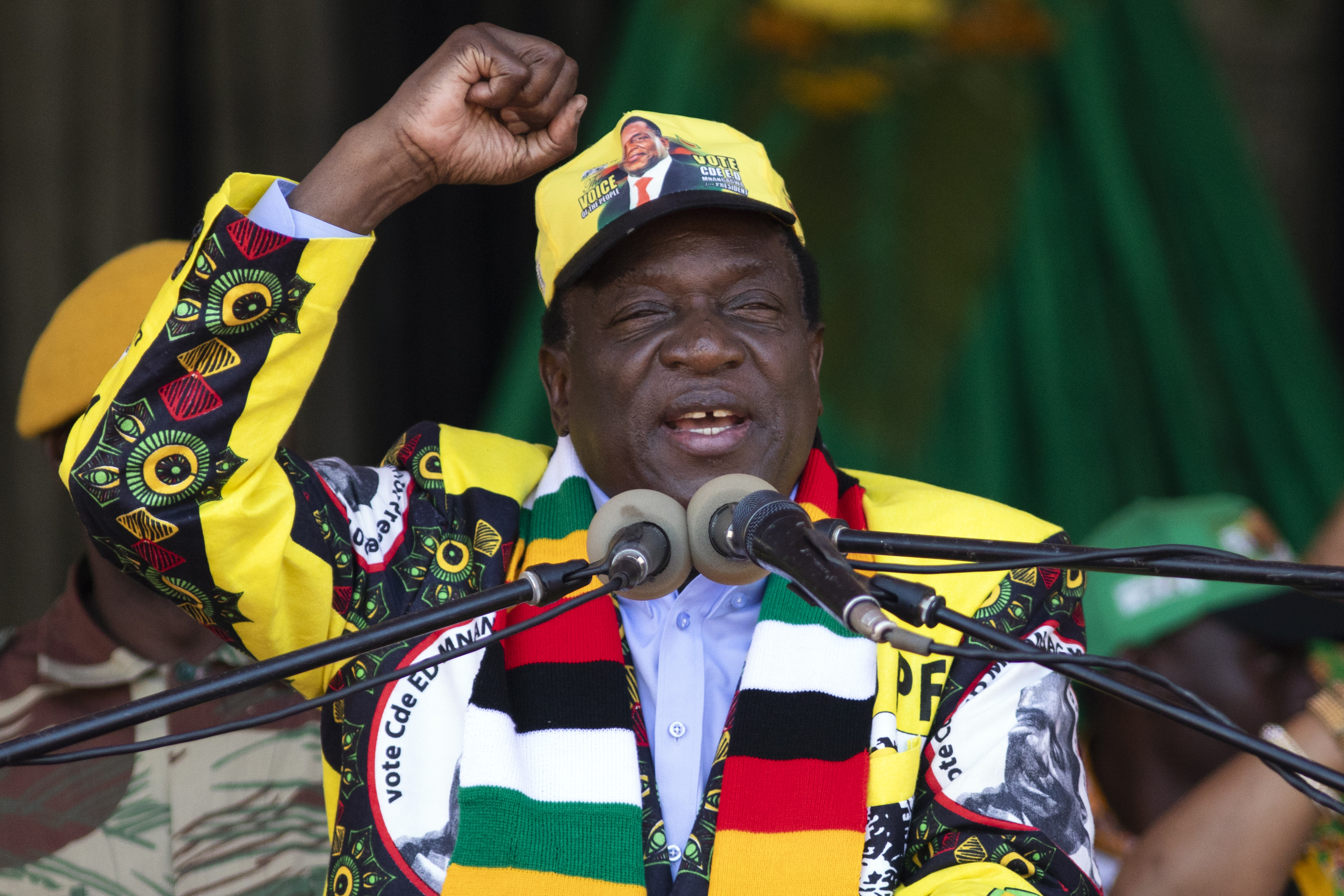 Zimbabwe's President Emmerson Mnangagwa speaks at a campaign rally at the National Sports Stadium on July 28, 2018.