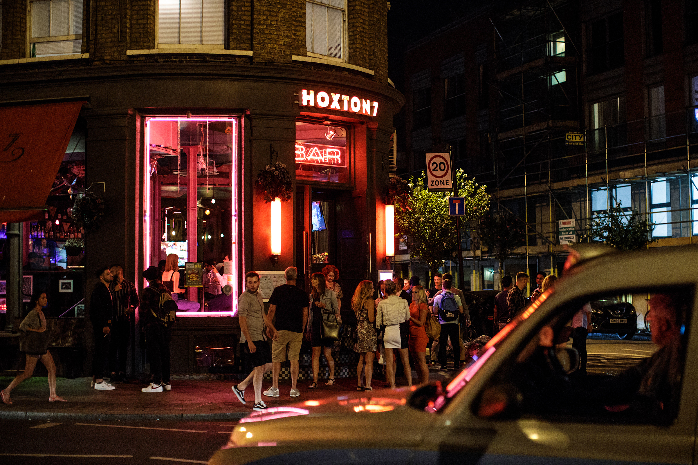 People gather outside a bar in Shoreditch, on July 28, 2018 in London, England.