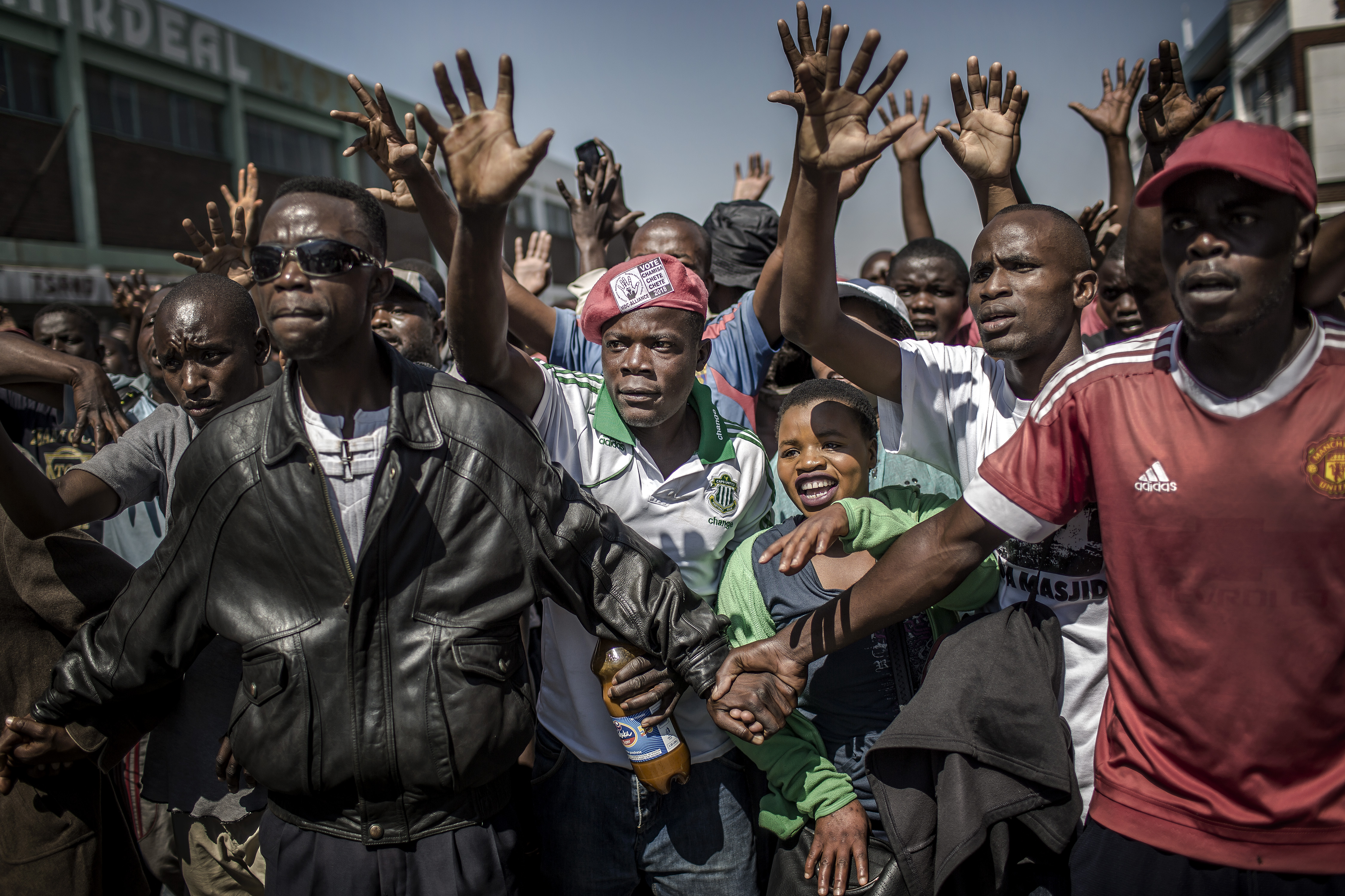 Supporters of the opposition party Movement for Democratic Change (MDC), protest against alleged election fraud in Harare, Zimbabwe on Aug. 1, 2018.