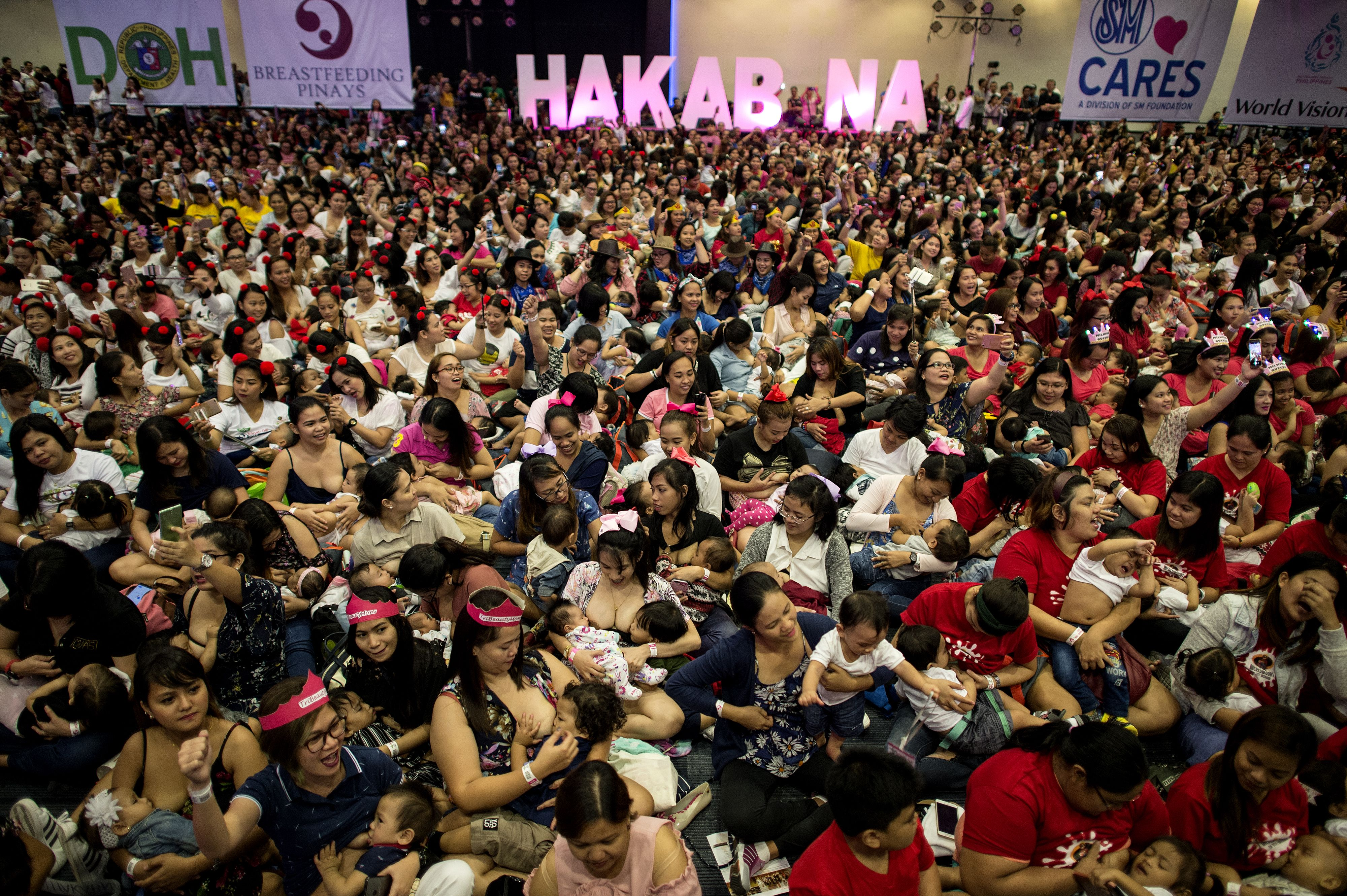 Mothers participate in a breastfeeding event in Manila on Aug. 5, 2018.
