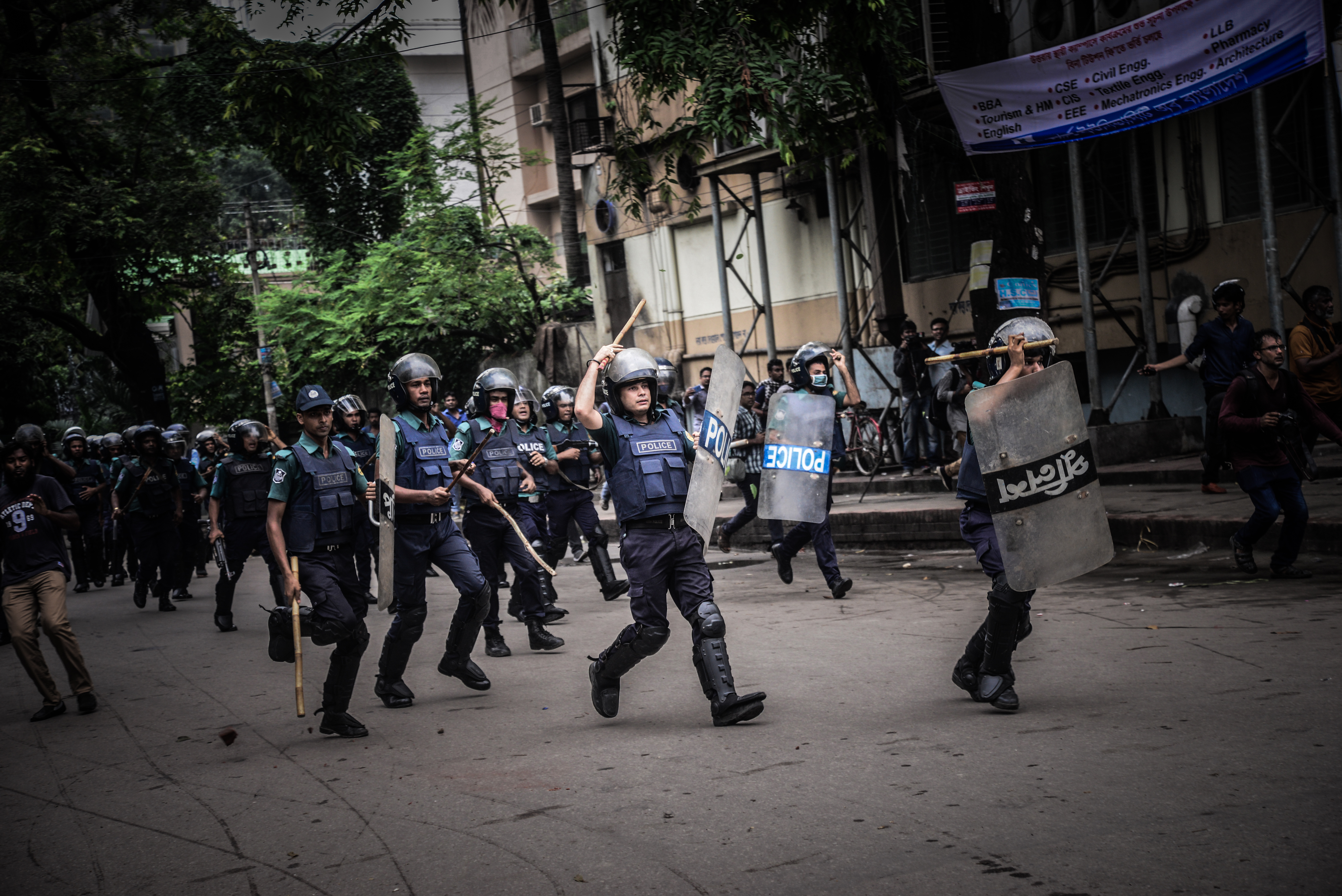 Bangladeshi police charge during a student protest in Dhaka on Aug. 5, 2018.
