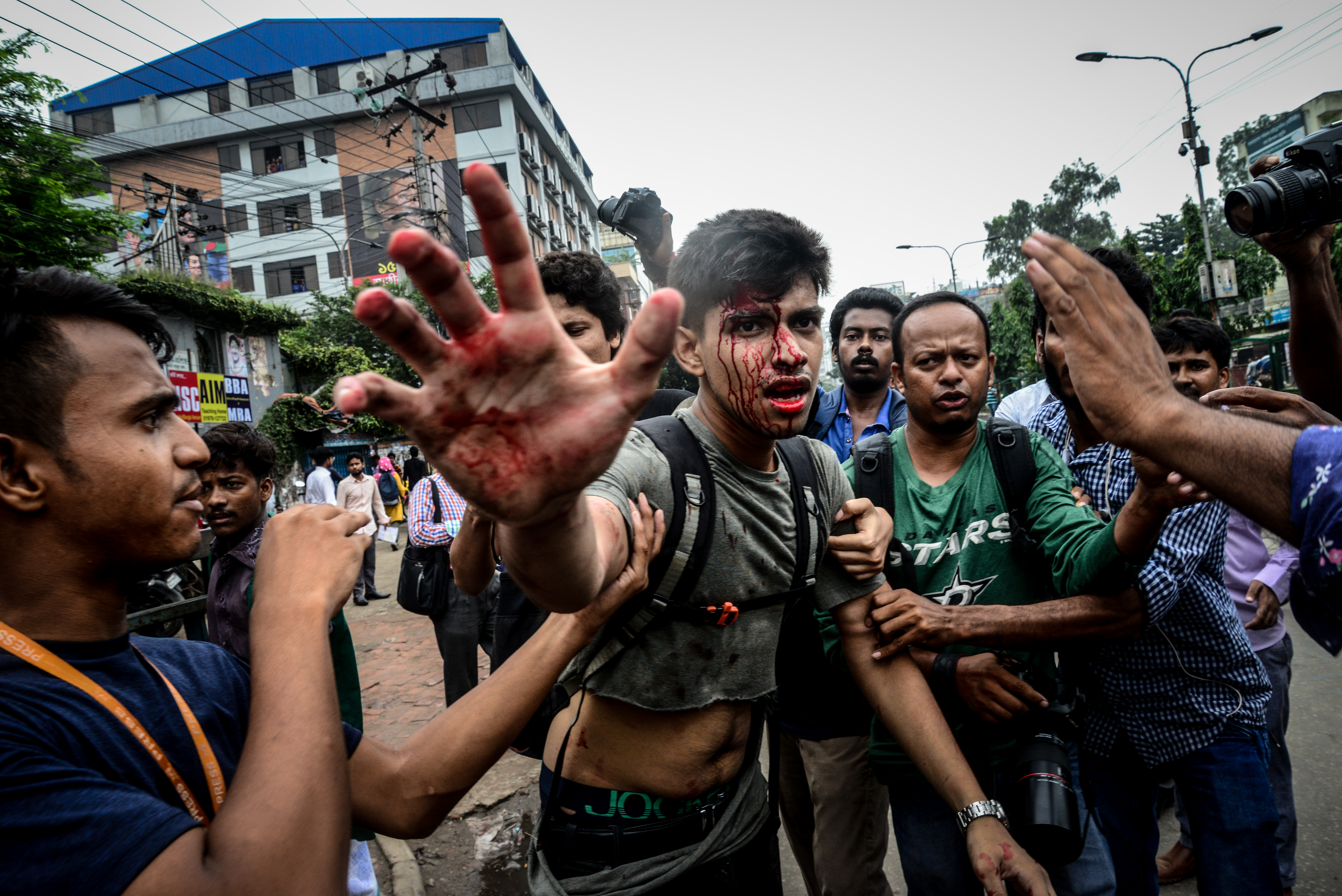 A photographer is attacked during a student protest in Dhaka on Aug. 5, 2018.